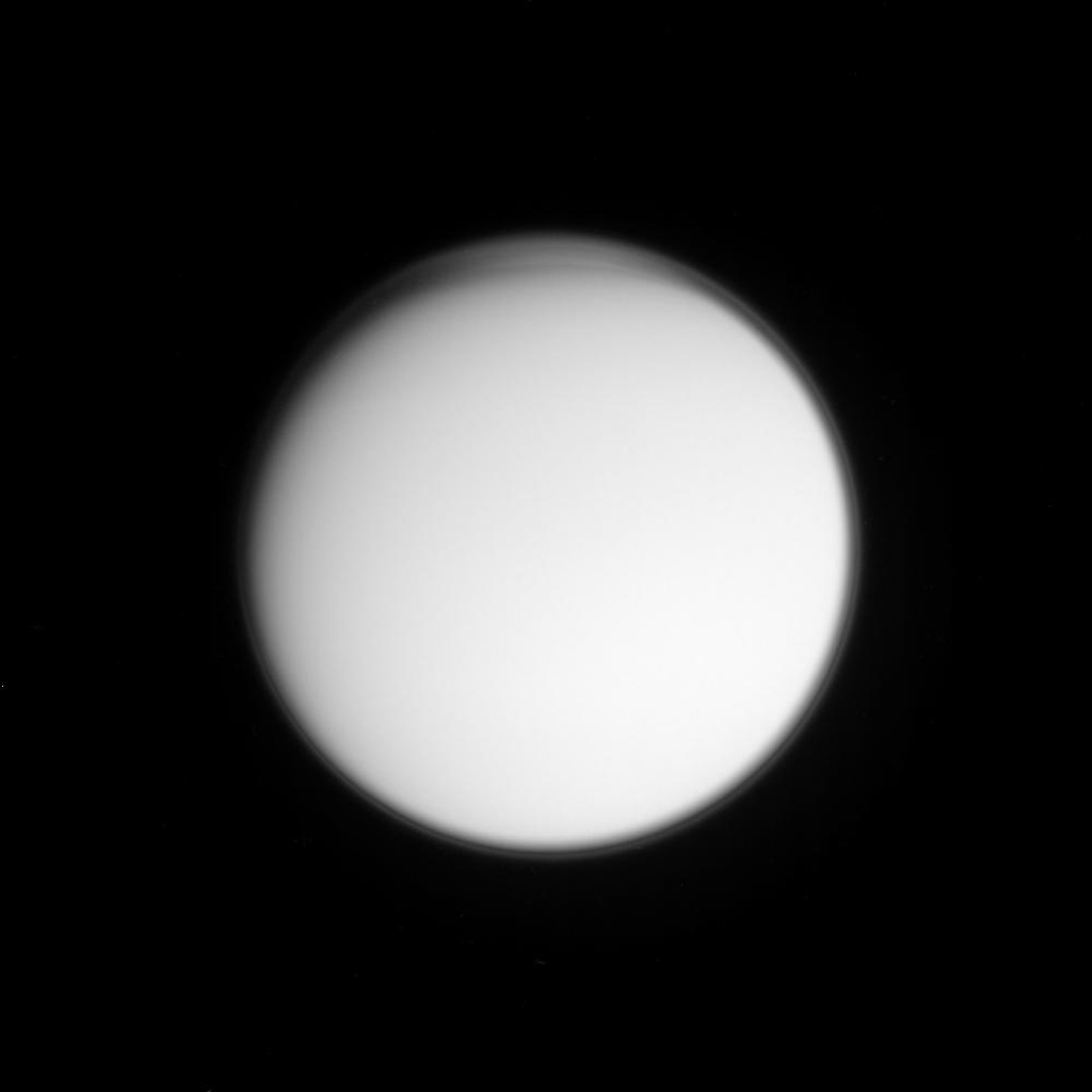 High-altitude haze and perhaps cloud layers are visible in this imaging science subsystem image acquired on Oct. 24, 2004, as NASA's Cassini spacecraft neared its first close encounter with Titan.