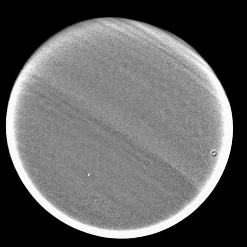This image captured by NASA's Cassini spacecraft was taken during Cassini's very close approach to Titan on Dec. 13, 2004. The view shows pronounced banding in the Titan atmosphere.