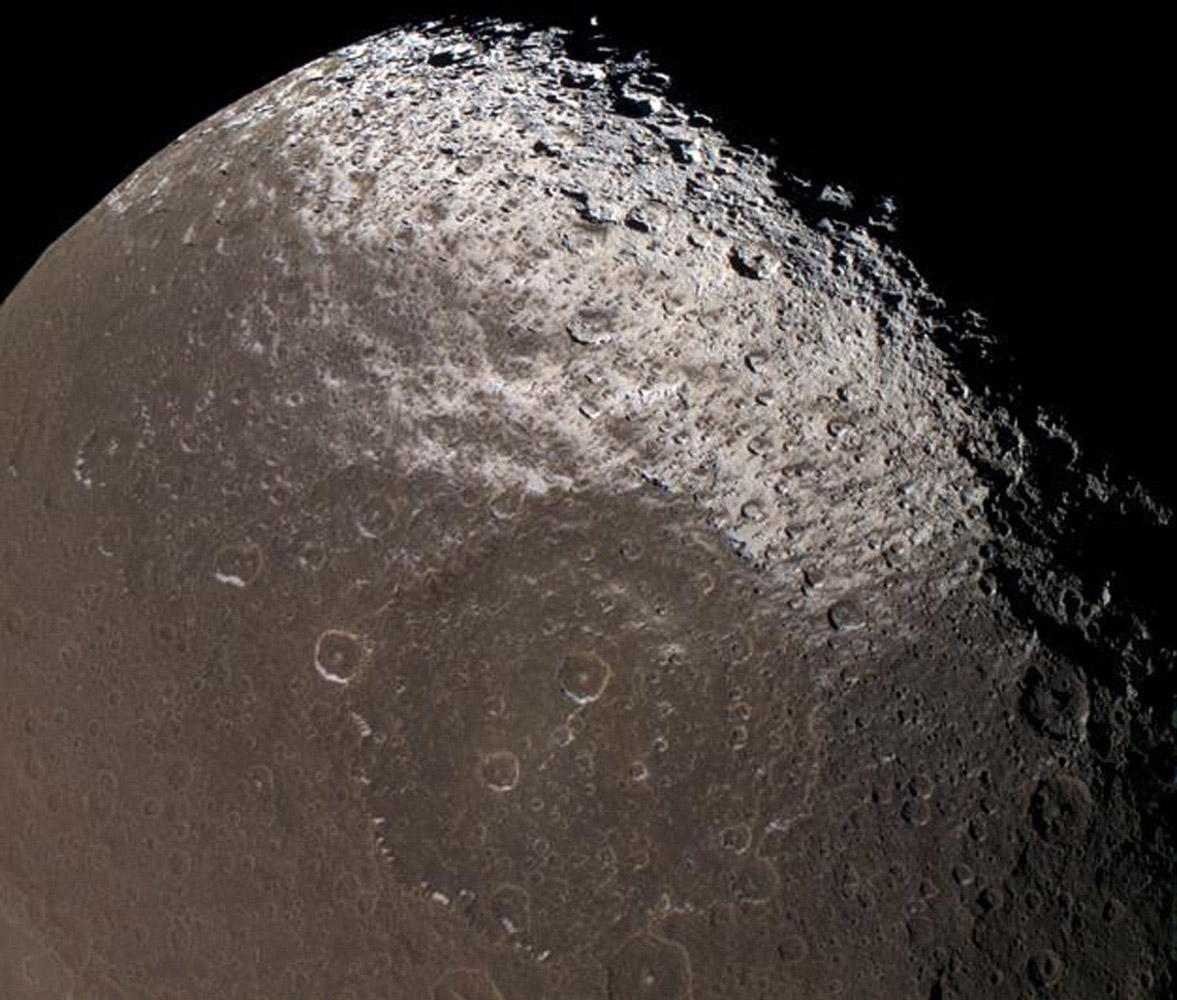 This image captured by NASA's Cassini spacecraft reveals the colorful and intriguing surface of Saturn's moon Iapetus in unrivaled clarity.