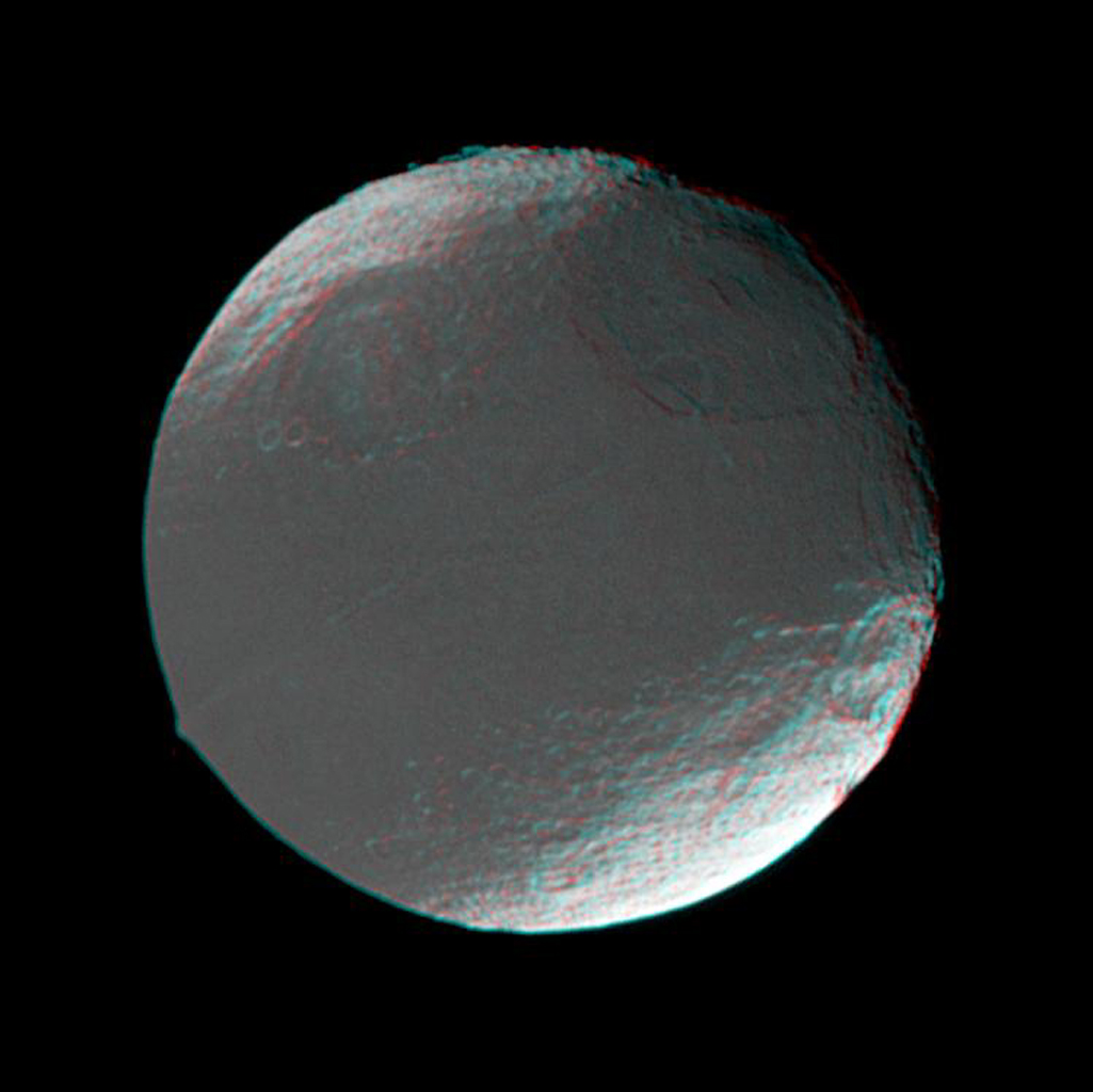 This stereo view of Iapetus was created by combining two NASA Cassini images, which were taken one day apart. The view serves mainly to show the spherical shape of Iapetus and some of the moon's topography. 3-D glasses are necessary to view this image.