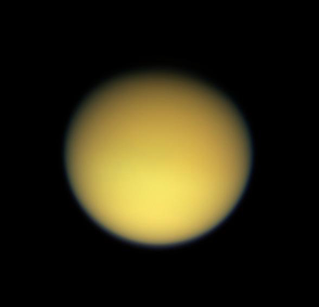 Saturn's large, smog-enshrouded moon Titan greets NASA's Cassini spacecraft in full color as the spacecraft makes its third close pass on Feb. 15, 2005.