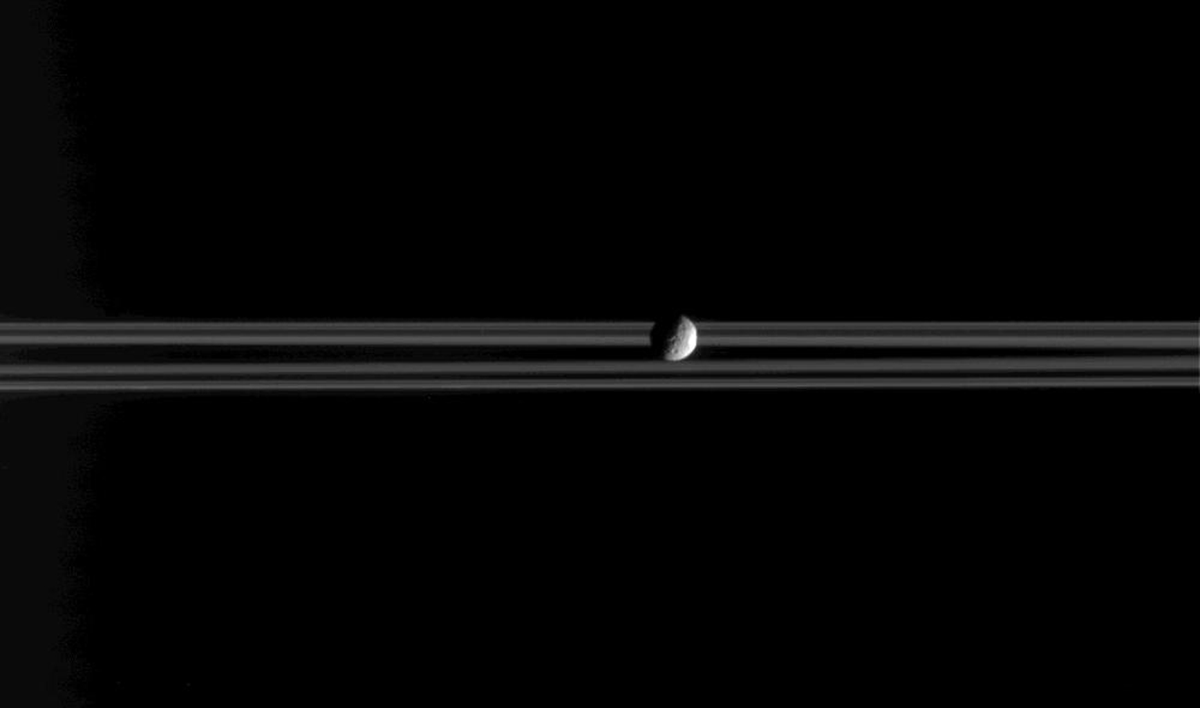 Mimas, a little moon of Saturn with a big crater, is the star of this image, a frame from a movie consisting of 37 individual frames taken over 20 minutes, while NASA's Cassini spacecraft remained sharply pointed at the icy worldlet.