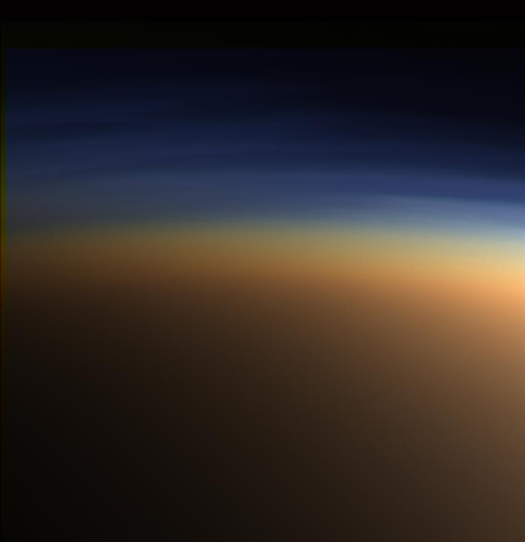 This natural color image from NASA's Cassini spacecraft shows Titan's upper atmosphere -- an active place where methane molecules are being broken apart by solar ultraviolet light and the byproducts combine to form compounds like ethane and acetylene.