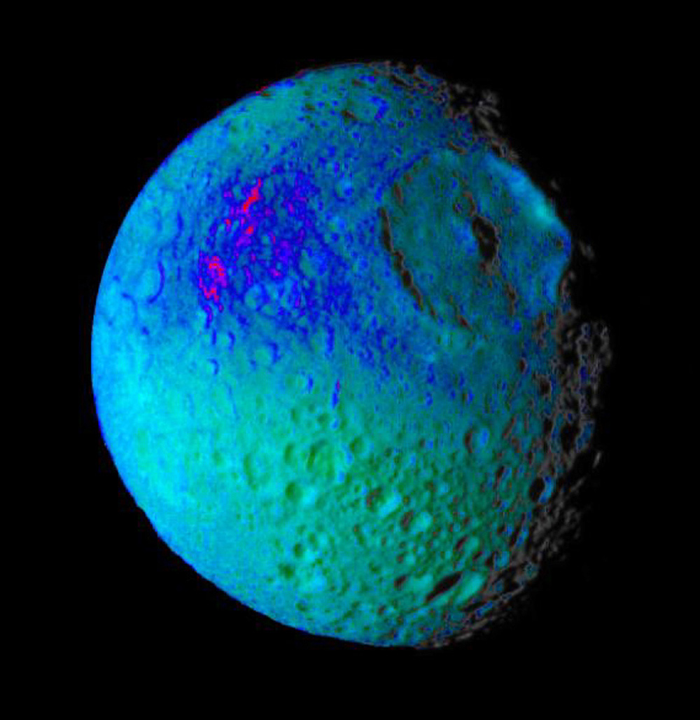 This false color image of Saturn's moon Mimas from NASA's Cassini spacecraft reveals variation in either the composition or texture across its surface.