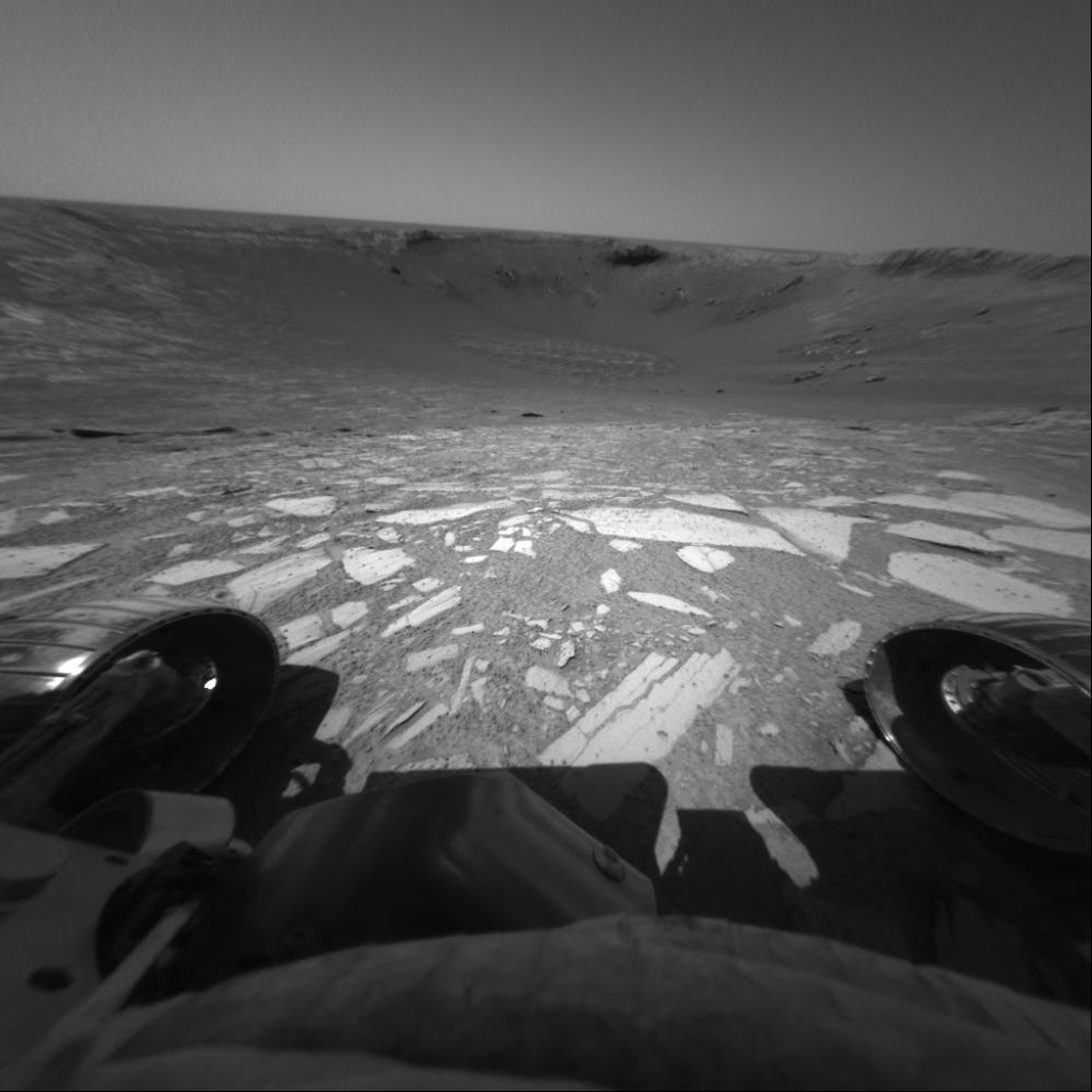 Perched on the edge of 'Endurance Crater,' NASA's Mars Exploration Rover Opportunity prepared to roll all six wheels in and then back out to the rim. This image was taken on June 8, 2004.