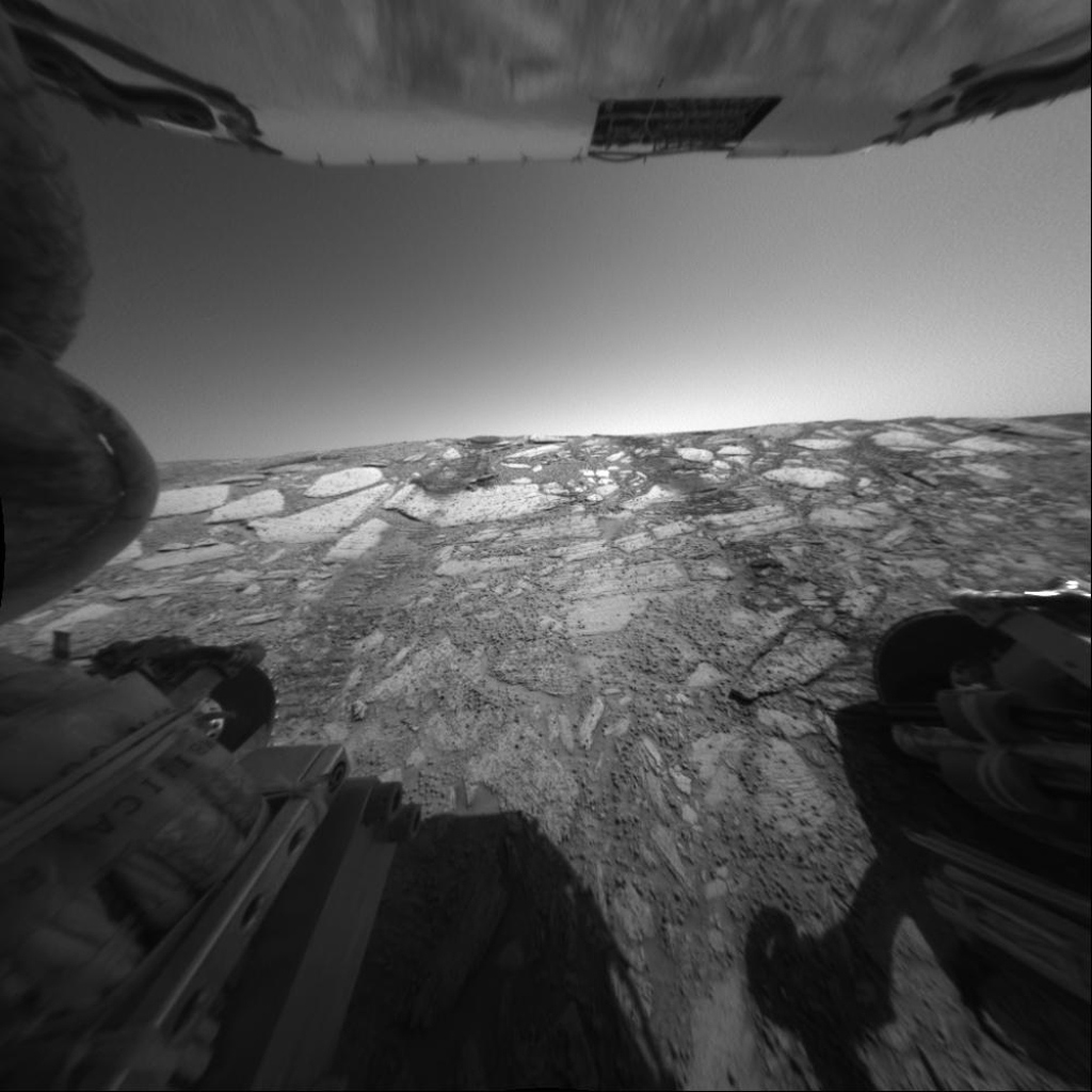 This view from NASA's Mars Exploration Rover Opportunity's rear hazard-avoidance camera looks back up toward the 'Endurance Crater' rim from the deepest point of a dip into the crater on June 9, 2004.