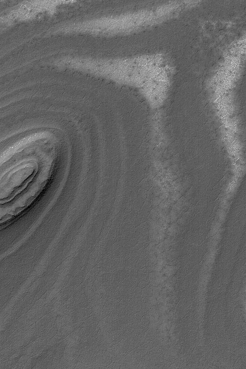 NASA's Mars Global Surveyor shows exposures of layered material on slopes in the south polar region on Mars.