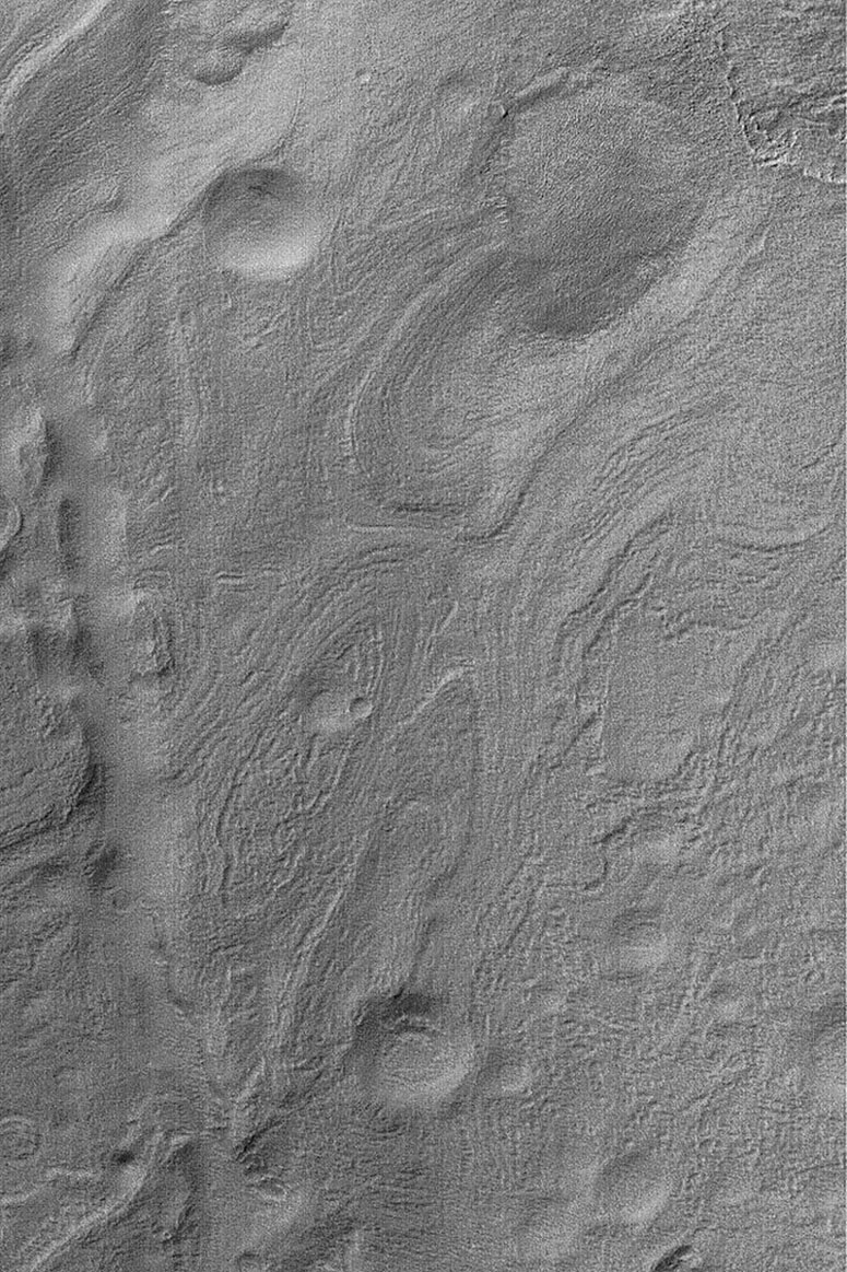 NASA's Mars Global Surveyor shows the banded southeastern floor of the giant impact basin, Hellas. Hellas Planitia is a large and varied region on Mars.