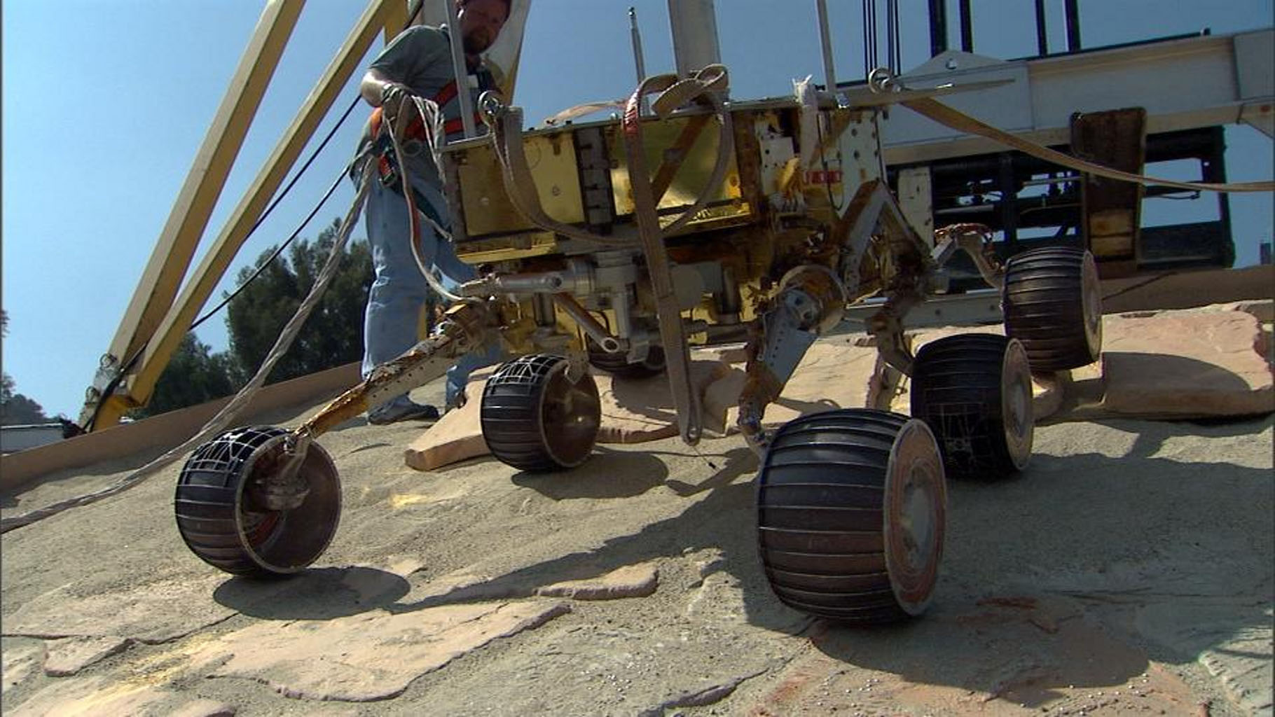 This image taken at NASA's Jet Propulsion Laboratory shows a rover test drive up a manmade slope.