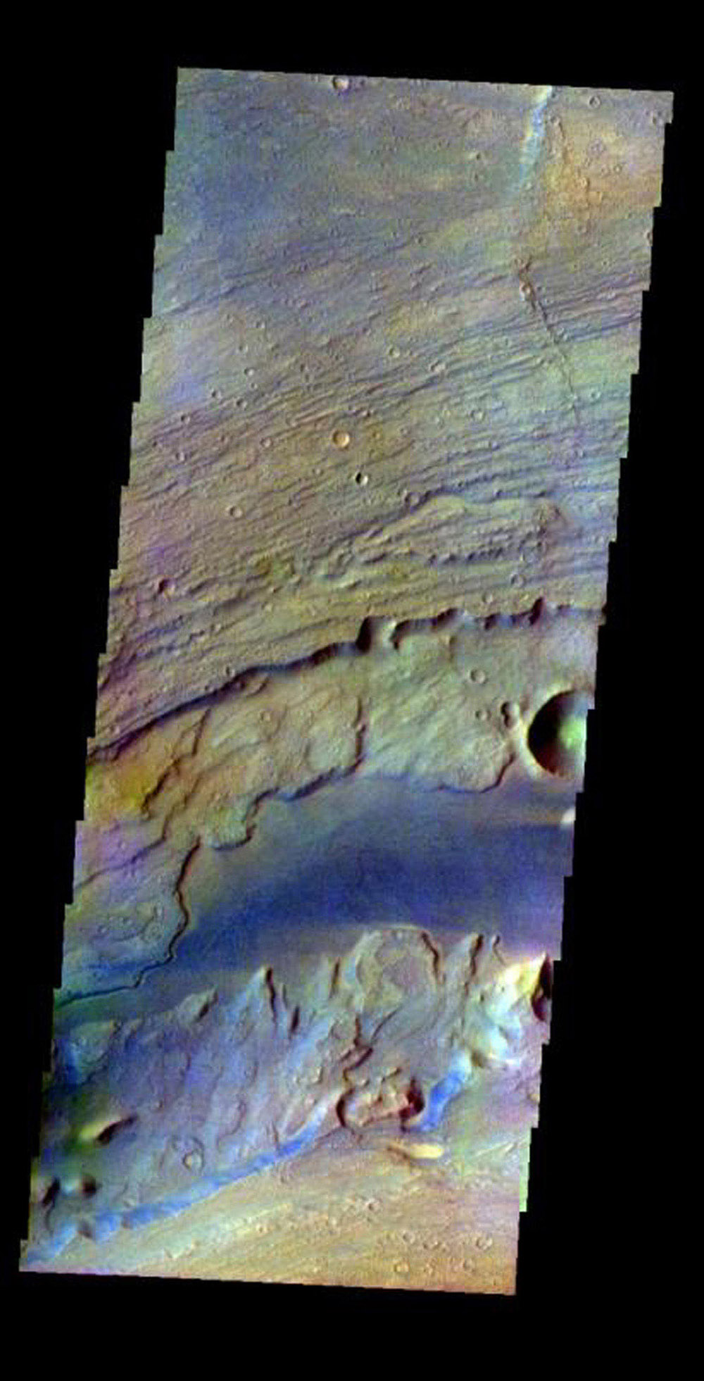 This image was collected July 17, 2002 during northern spring season on Mars. The image shows an area in the Kasei Valles region as seen by NASA's 2001 Mars Odyssey.