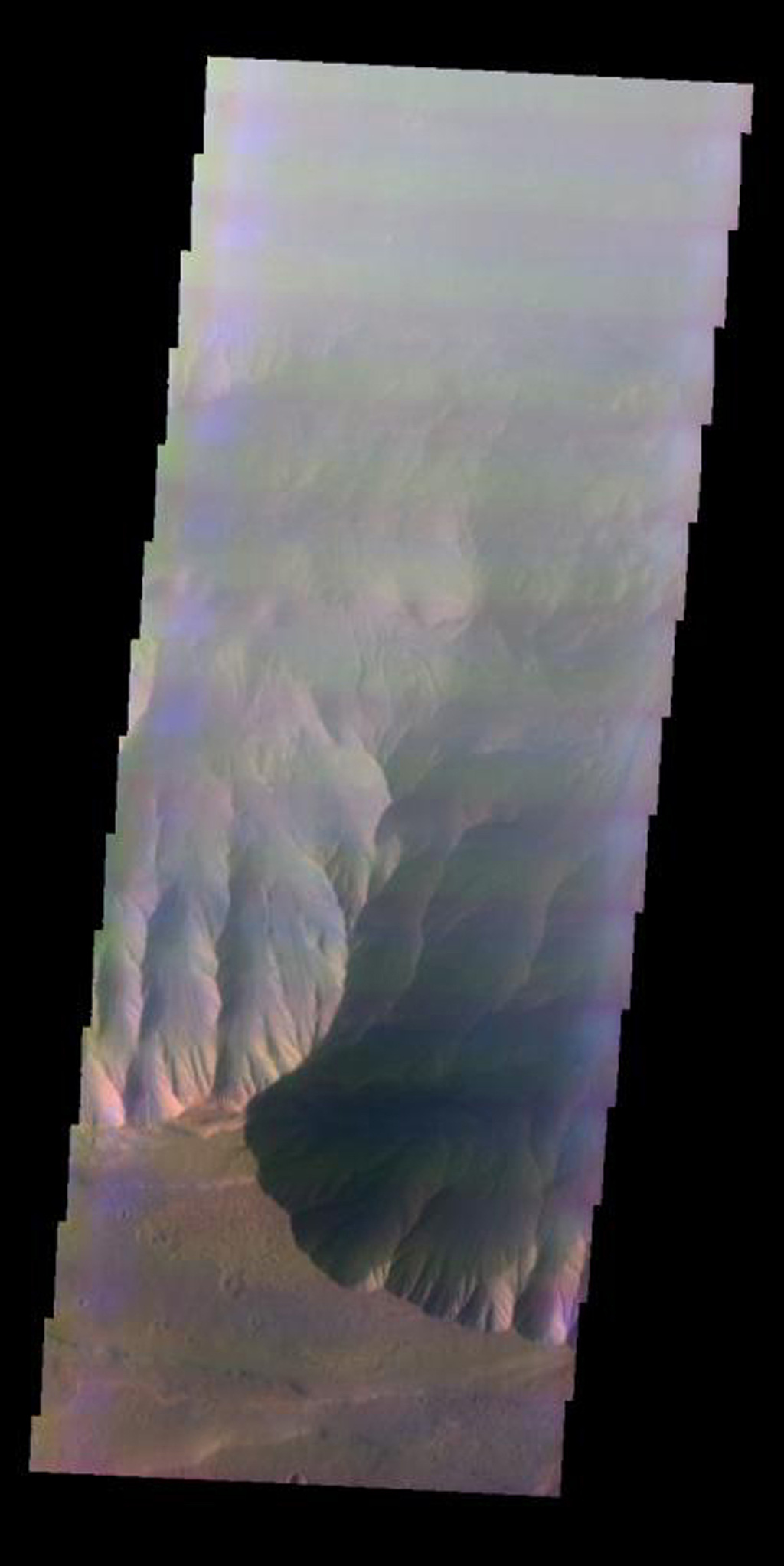 This false-color image released on June 4, 2004 from NASA's 2001 Mars Odyssey was collected March 12, 2003 during southern winter season. The image shows an area in the Coprates Chasma region on Mars.