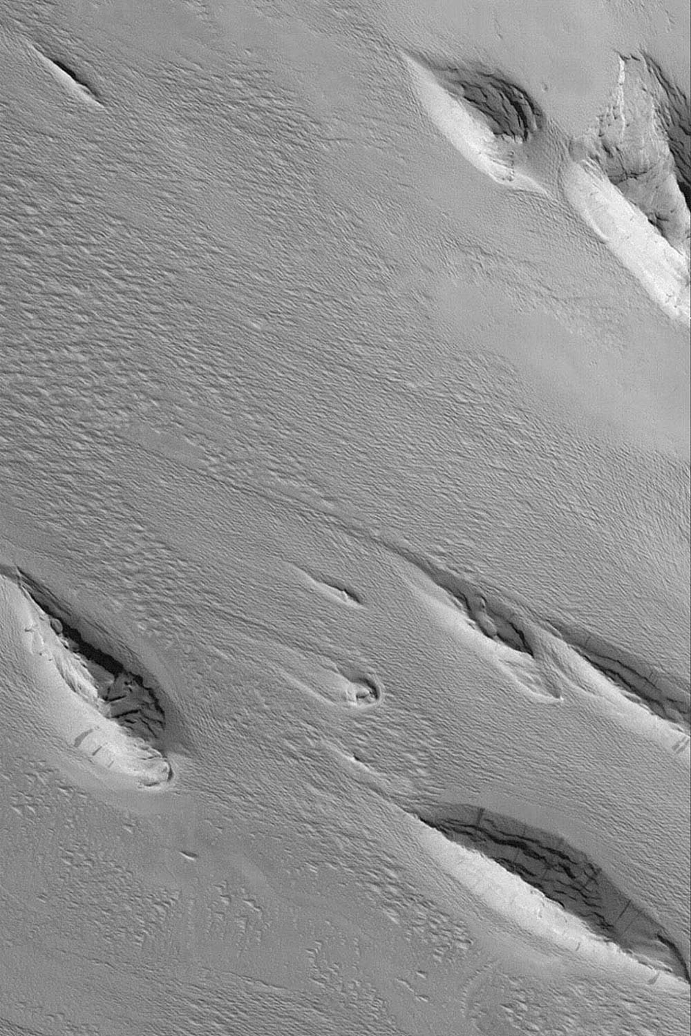 NASA's Mars Global Surveyor shows landforms found in the Medusae Sulci region of Mars. The most classic yardang shape is that of the inverted boat hull.