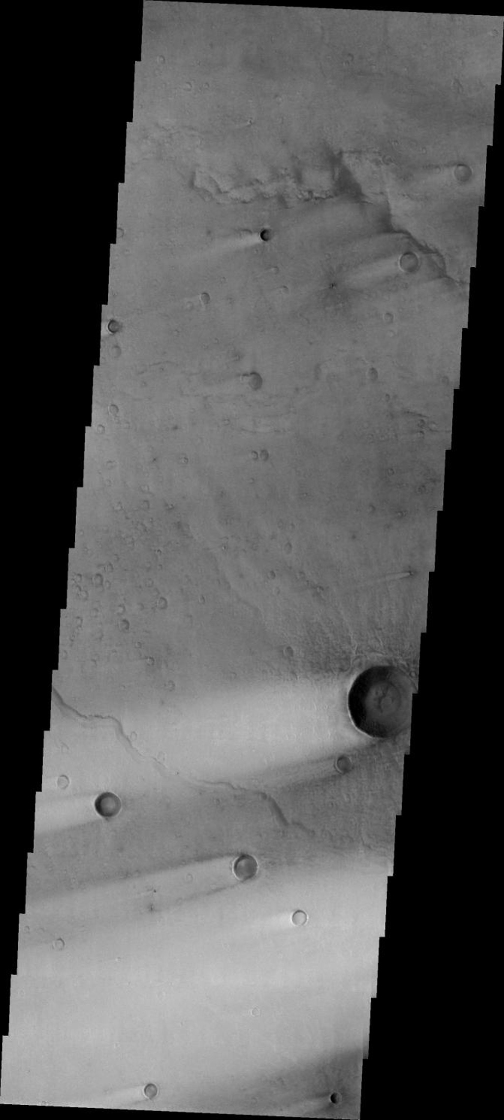 This image released on July 12, 2004 from NASA's 2001 Mars Odyssey shows windstreaks are features caused by the interaction of wind and topographic landforms such as raised rims and bowls of impact craters on Mars.