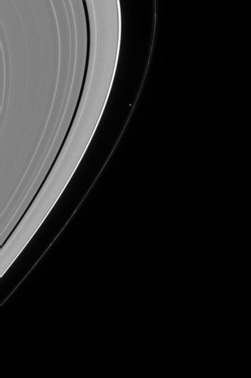 This image captured by NASA's Cassini spacecraft shows Saturn's moon Prometheus shepherding the inner edge of Saturn's F ring.