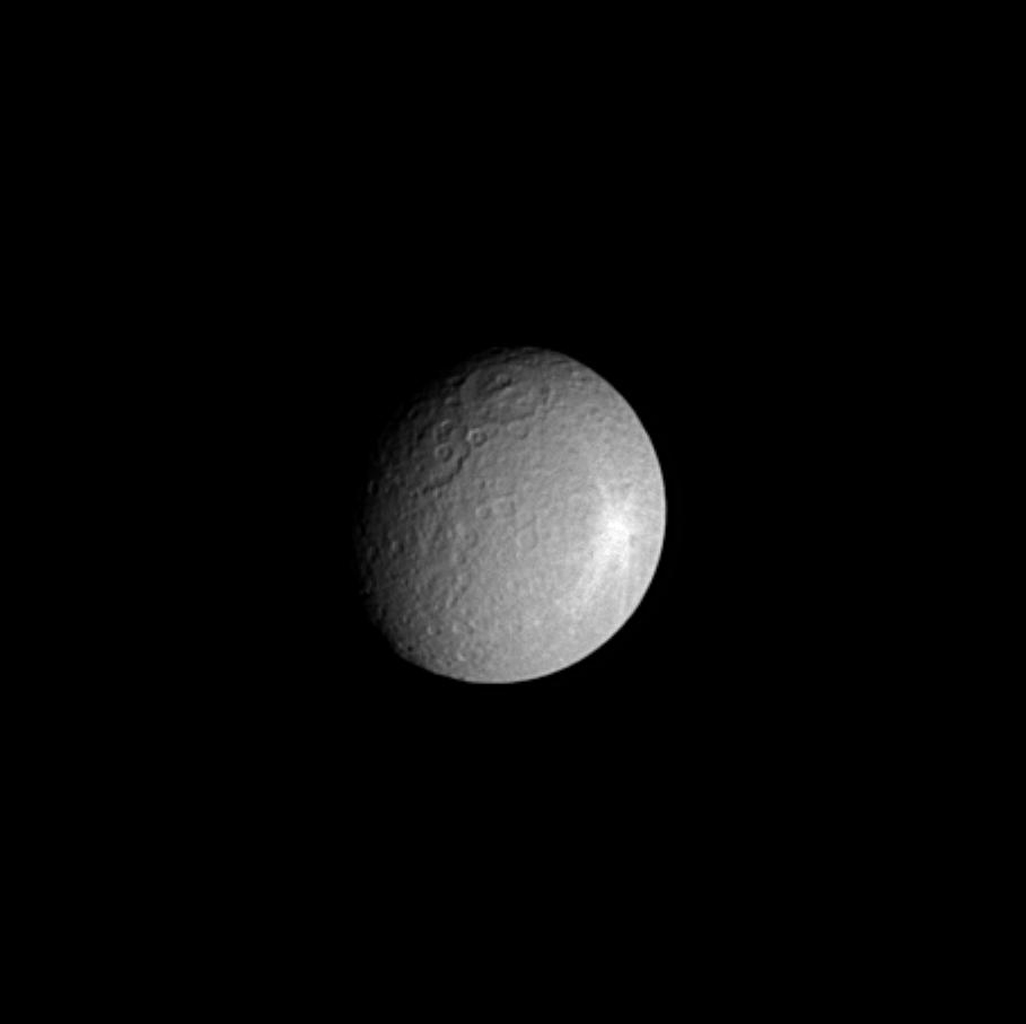 This image captured by NASA's Cassini spacecraft shows Saturn's moon Rhea, which is about half the size of Earth's moon. At 1,528 kilometers (949 miles) across, it is the second-largest moon orbiting Saturn.