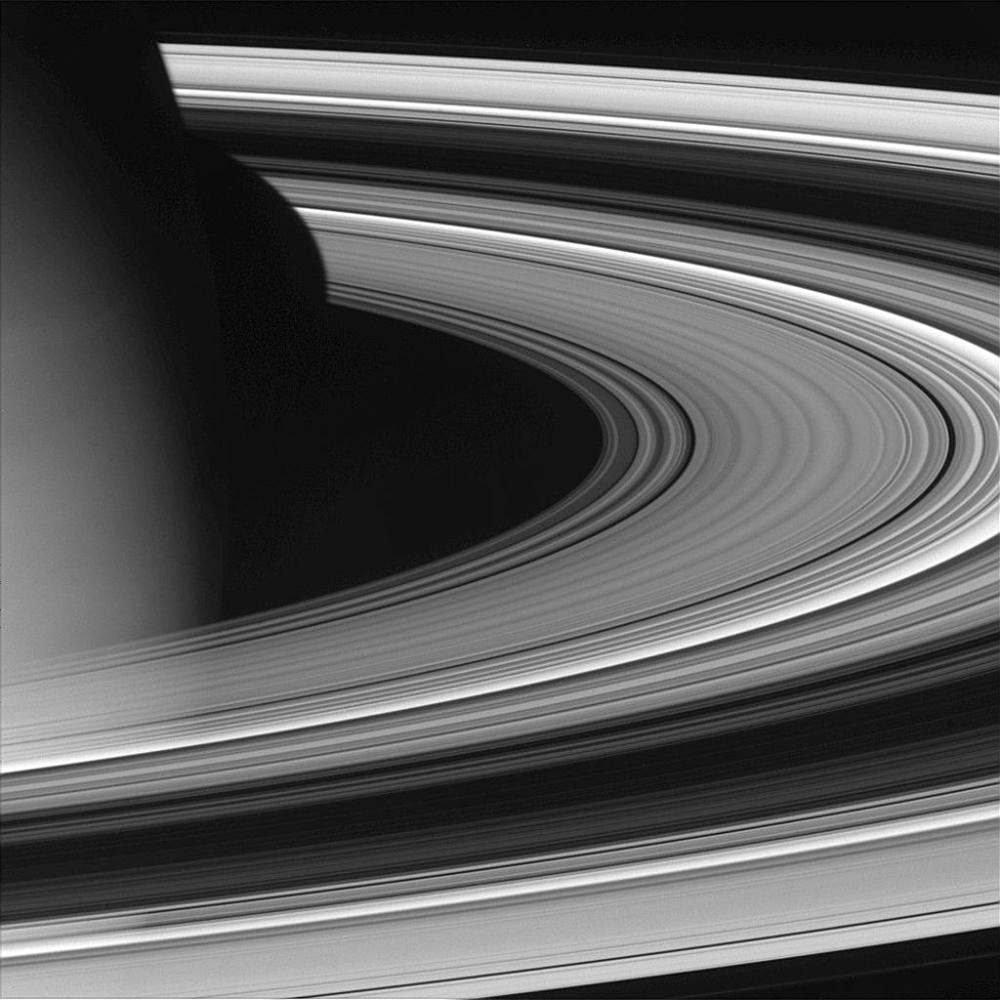 NASA's Cassini spacecraft pierced the ring plane and rounded Saturn on Oct. 27, 2004, capturing this view of the dark portion of the rings.