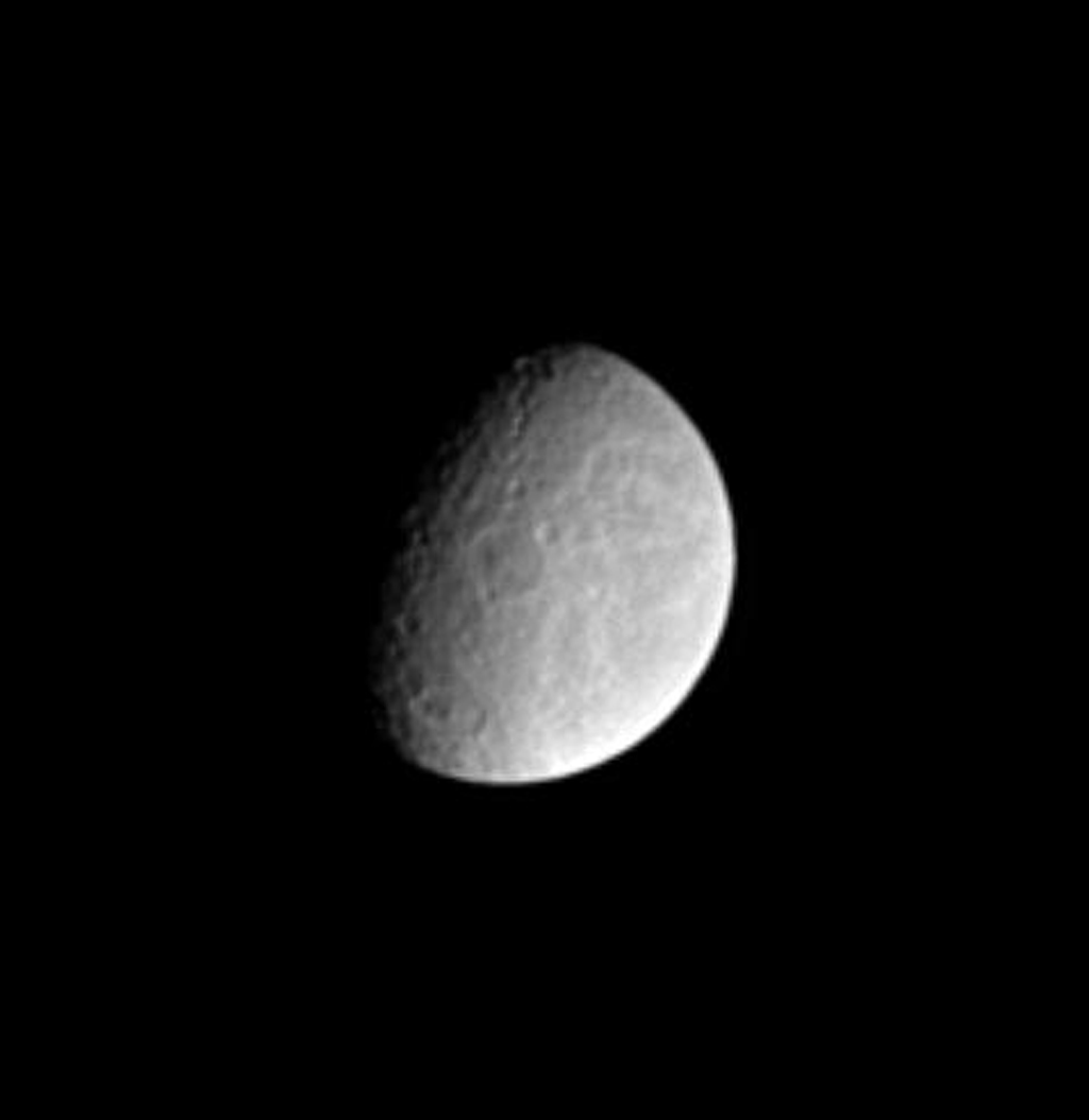 Features on the surface of Saturn's moon Rhea reveal clues about the moon's history. This image from NASA's Cassini spacecraft shows two large impact basins near center and bottom exhibit central peaks.
