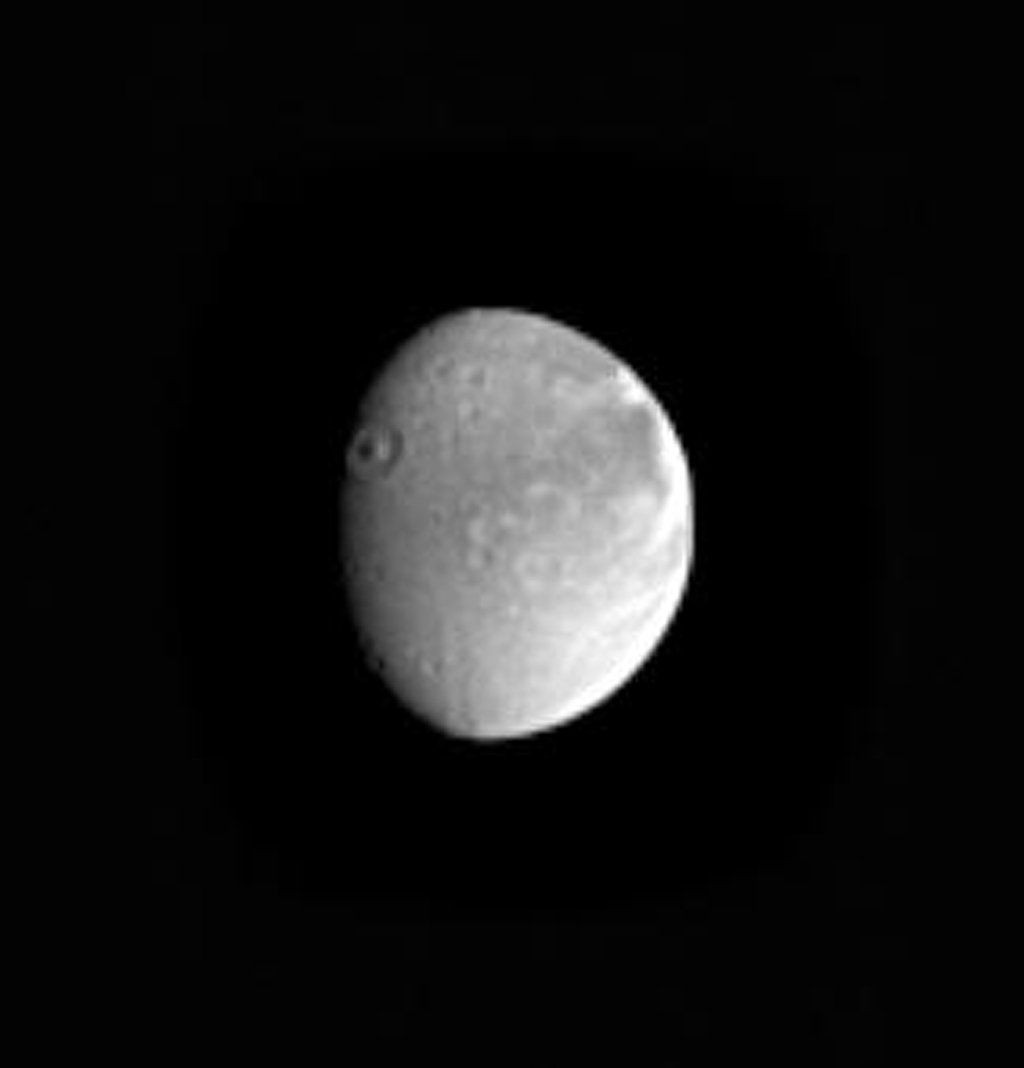 This image of Saturn's moon Dione from NASA's Cassini spacecraft shows a nice view of the crater Aeneas on the terminator taken on Dec. 10, 2004.