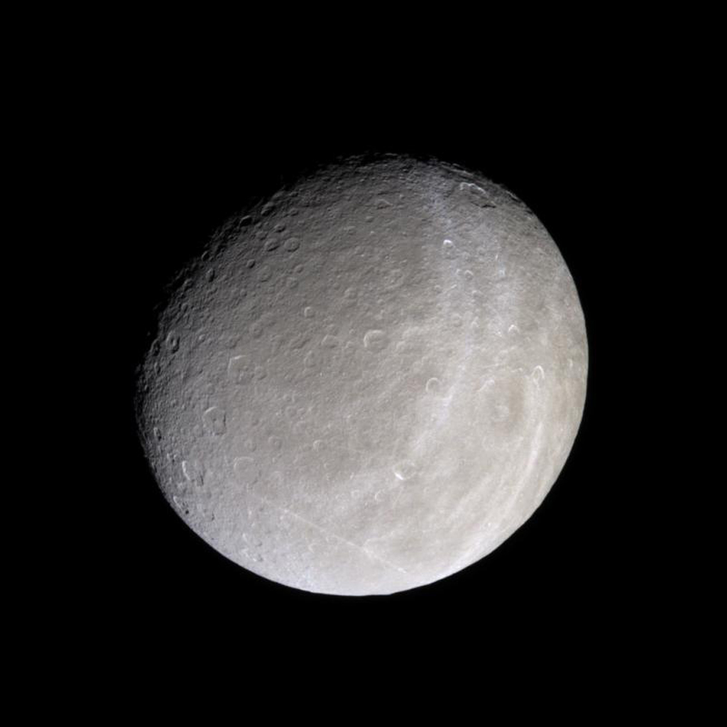 This image captured by NASA's Cassini spacecraft shows the trailing hemisphere of Saturn's moon Rhea, seen here in natural color.
