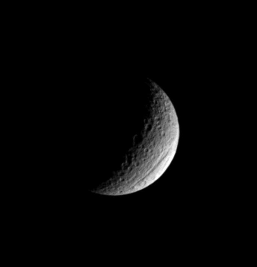 Ithaca Chasma is one of the two most prominent features on Saturn's moon Tethys; the other is the gigantic crater Odysseus. Ithaca Chasma is visible near the moon's lower right limb in this image captured by NASA's Cassini spacecraft.