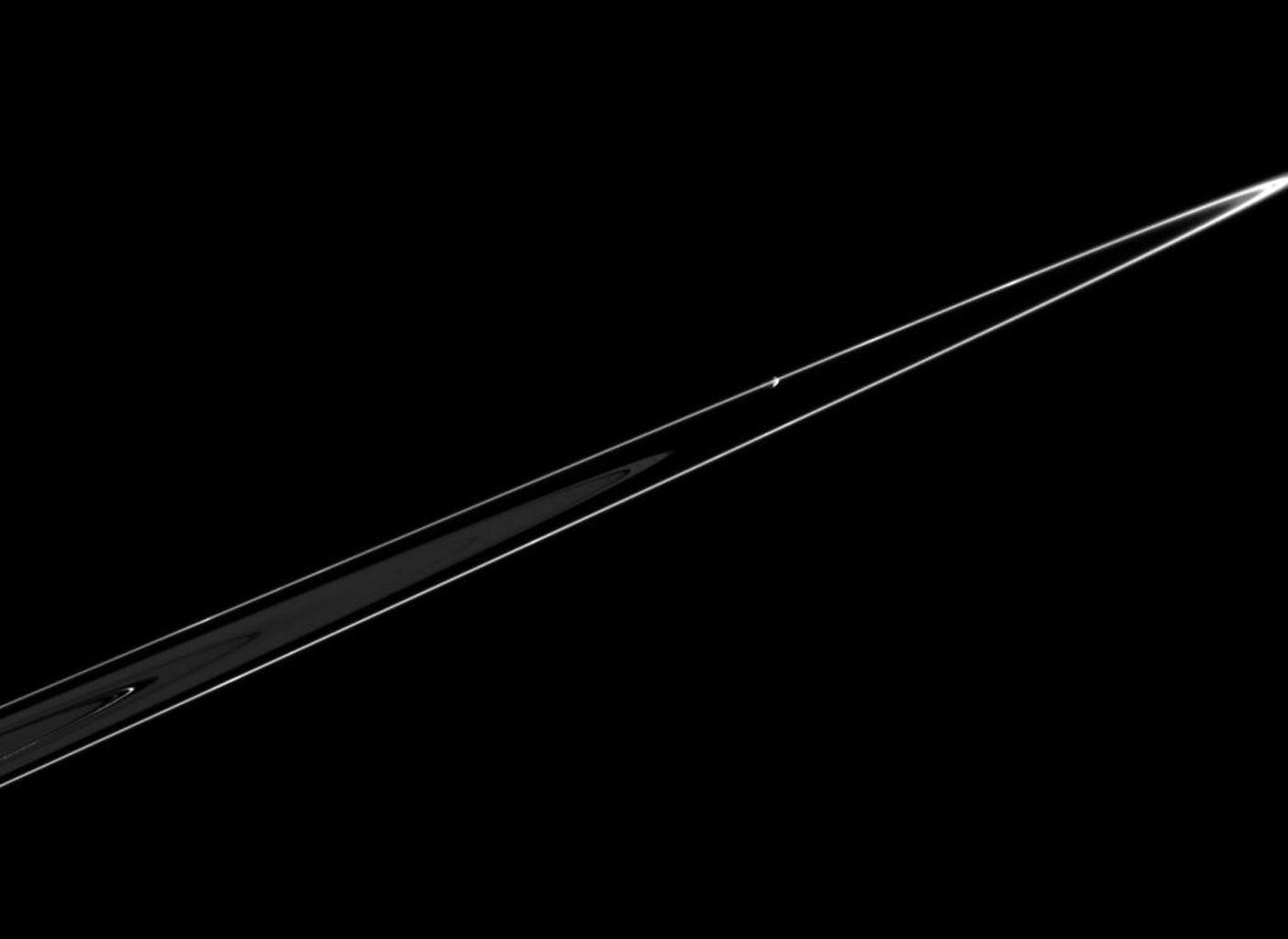 Pandora is seen in this dramatic view, orbiting just beyond the outer edge of Saturn's F ring. This image was taken in visible light with NASA's Cassini spacecraft's narrow-angle camera on Feb. 18, 2005.