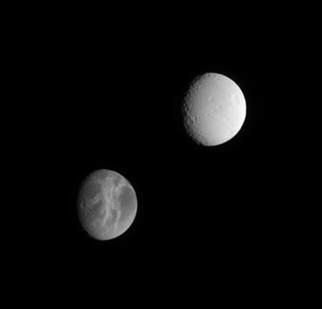 NASA's Cassini spacecraft offers this lovely comparison between two of Saturn's satellites, Dione and Tethys, which are similar in size but have very different surfaces.