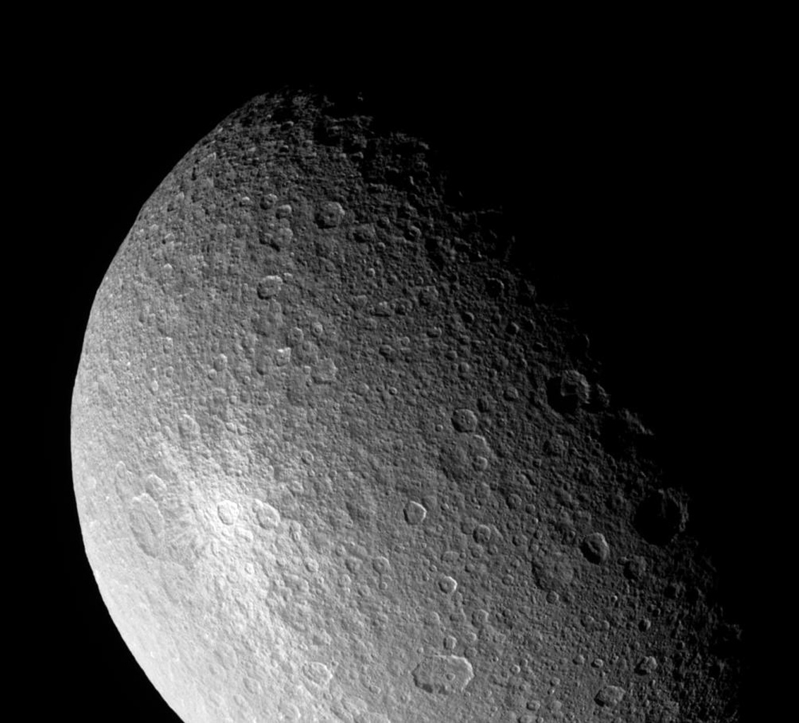Looking closely at Saturn's moon Rhea during a somewhat distant flyby, NASA's Cassini spacecraft provides this view of what appears to be a bright, rayed and therefore relatively young crater.