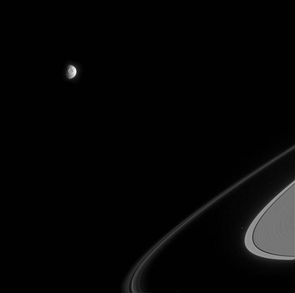 The great eye of Saturn's moon Mimas, a 130-kilometer-wide impact crater called Herschel, stares out from the battered moon, as shown in this image from NASA's Cassini spacecraft.