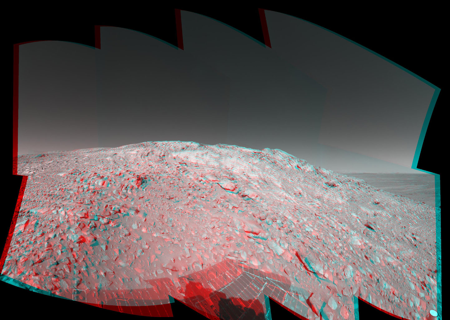 In this stereo image, a rock outcrop with a view of the surrounding landscape beckons NASA's Mars Exploration Rover Spirit on sol 203. 3D glasses are necessary to view this image.