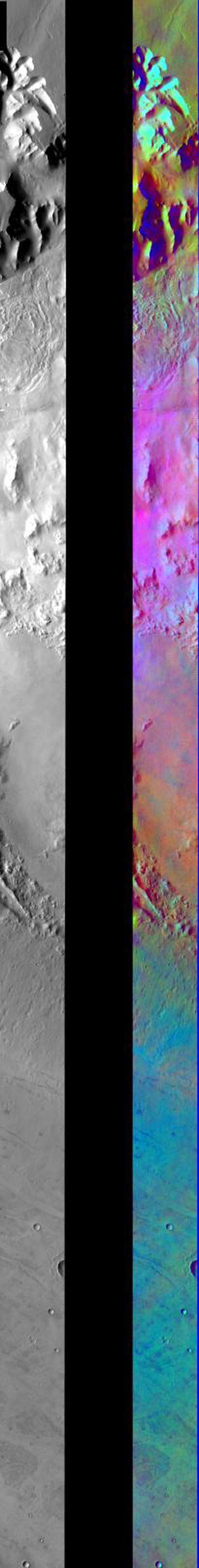 This image released on August 3, 2004 from NASA's 2001 Mars Odyssey shows a decorrelation stretch in parts of Ius Chasma/Oudemans Crater. Pink/magenta colors usually represent basaltic dunes, cyan the presence of water ice clouds, while green can be dust.