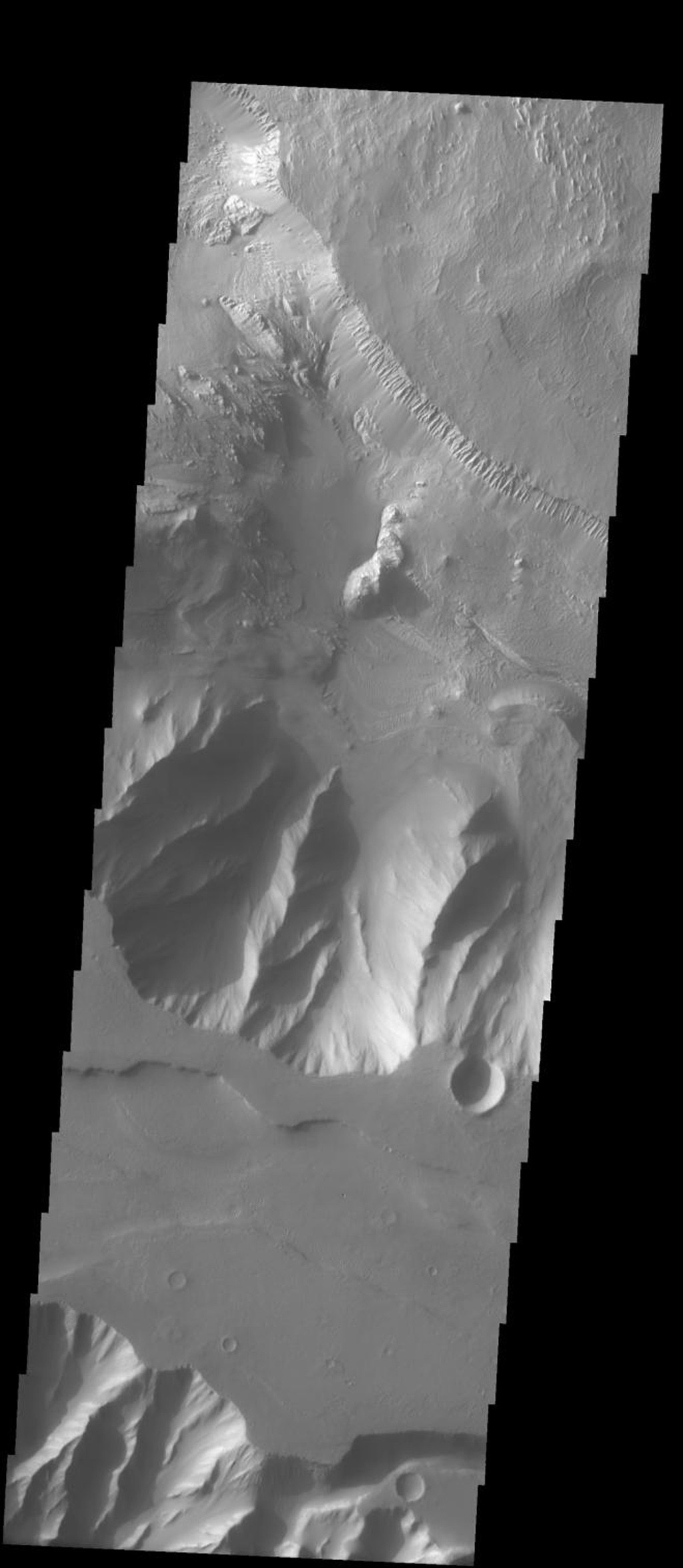 This image released on Sept 21, 2004 from NASA's 2001 Mars Odyssey shows the bordering areas between Ophir Chasma and Candor Chasma on Mars. Wind etched surfaces, and dunes are present on the floor of Ophir Chasma.