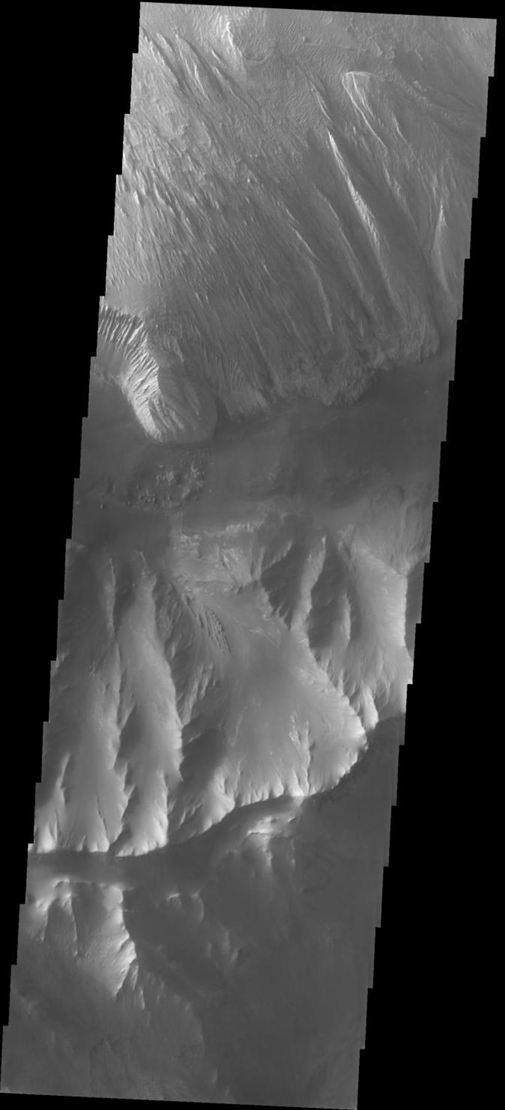 This image released on Sept 23, 2004 from NASA's 2001 Mars Odyssey shows a hill formation on Mars separating Ophir and Candor Chasmas and an interesting wind etched rock formation in Ophir Chasma.