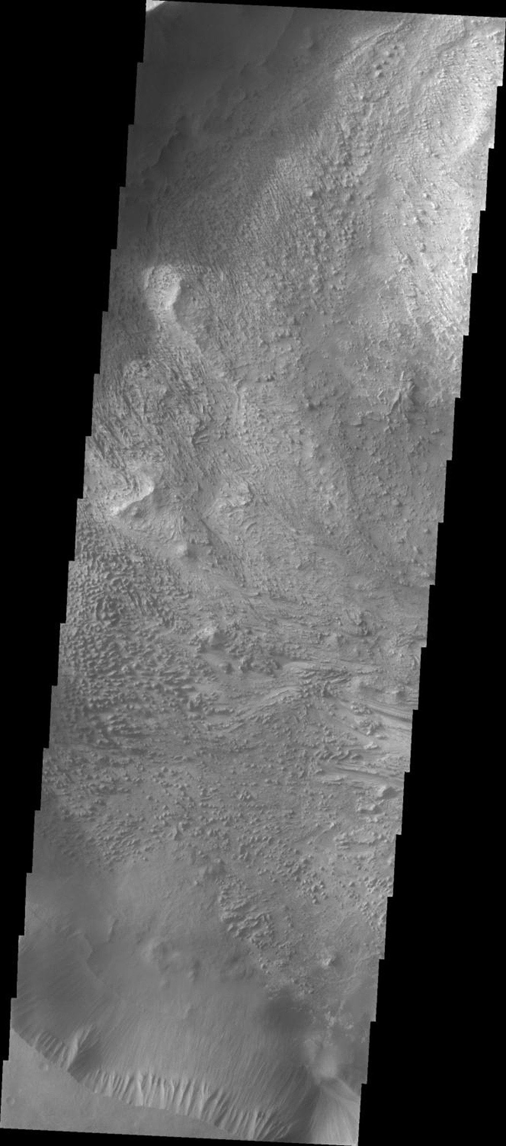 This image released on Sept 29, 2004 from NASA's 2001 Mars Odyssey shows a wind etched area on Mars in Candor Chasma.