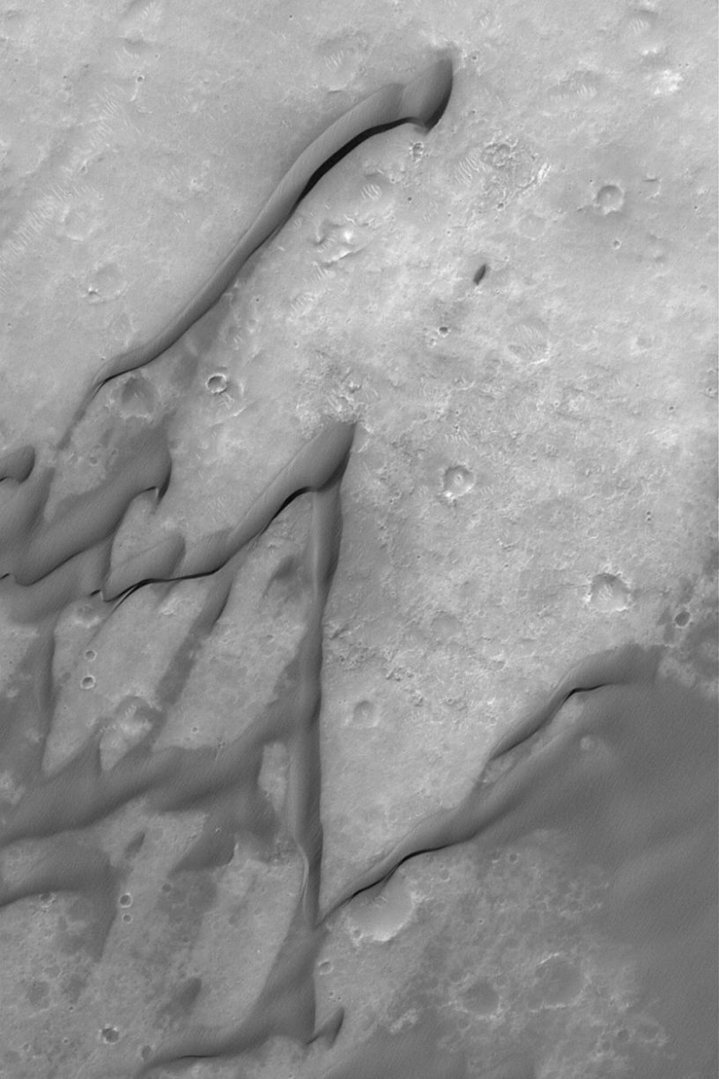 NASA's Mars Global Surveyor shows windblown sand dunes in Herschel Basin, a large impact crater in the Terra Cimmeria region of Mars. The dunes of Herschel have grooved surfaces, indicating that their sands are somewhat cemented.