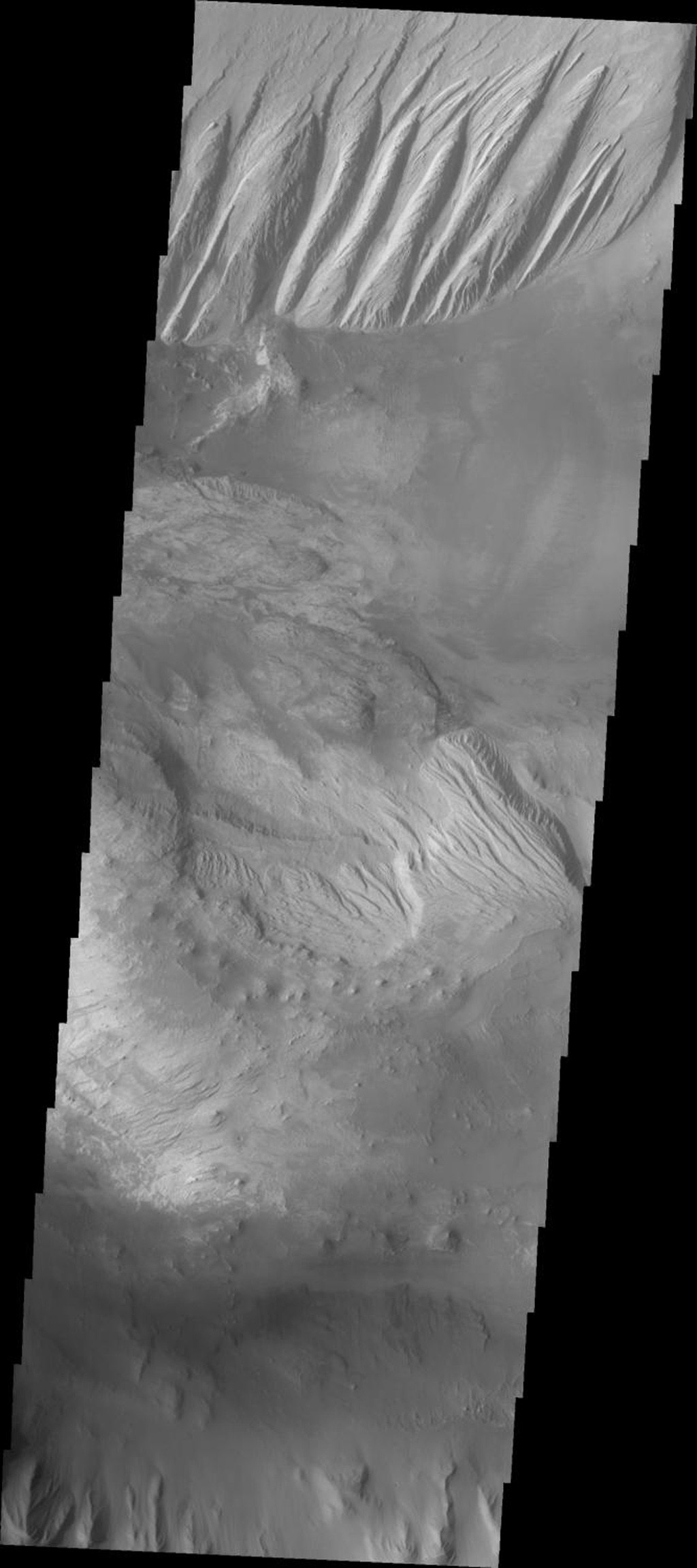 This image released on Oct 5, 2004 from NASA's 2001 Mars Odyssey shows an area on Mars in Candor Chasma. The imaged area is close to the depression that connects Candor and Melas Chasmas together.