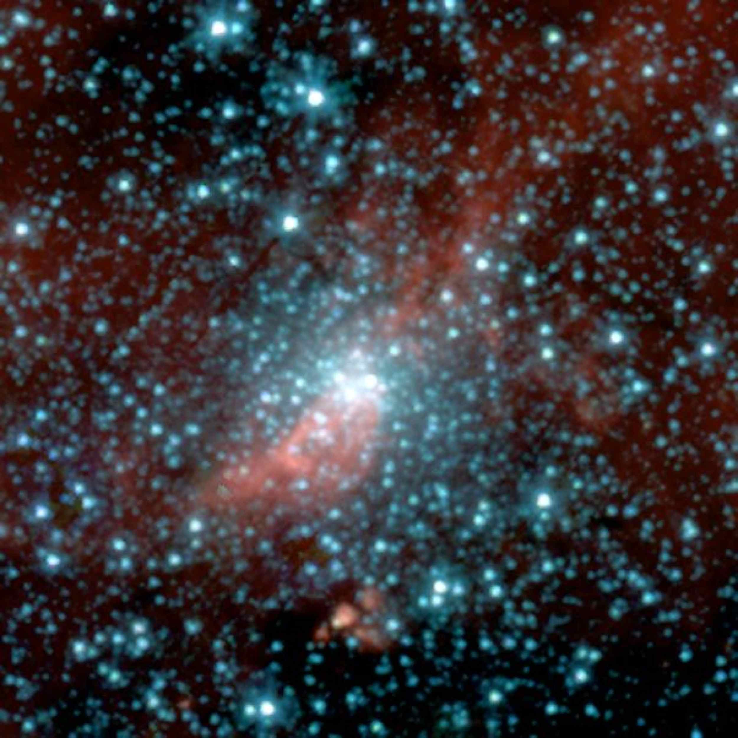 This false-color image taken by NASA's Spitzer Space Telescope shows a globular cluster previously hidden in the dusty plane of our Milky Way galaxy. Globular clusters are compact bundles of old stars that date back to the birth of our galaxy.