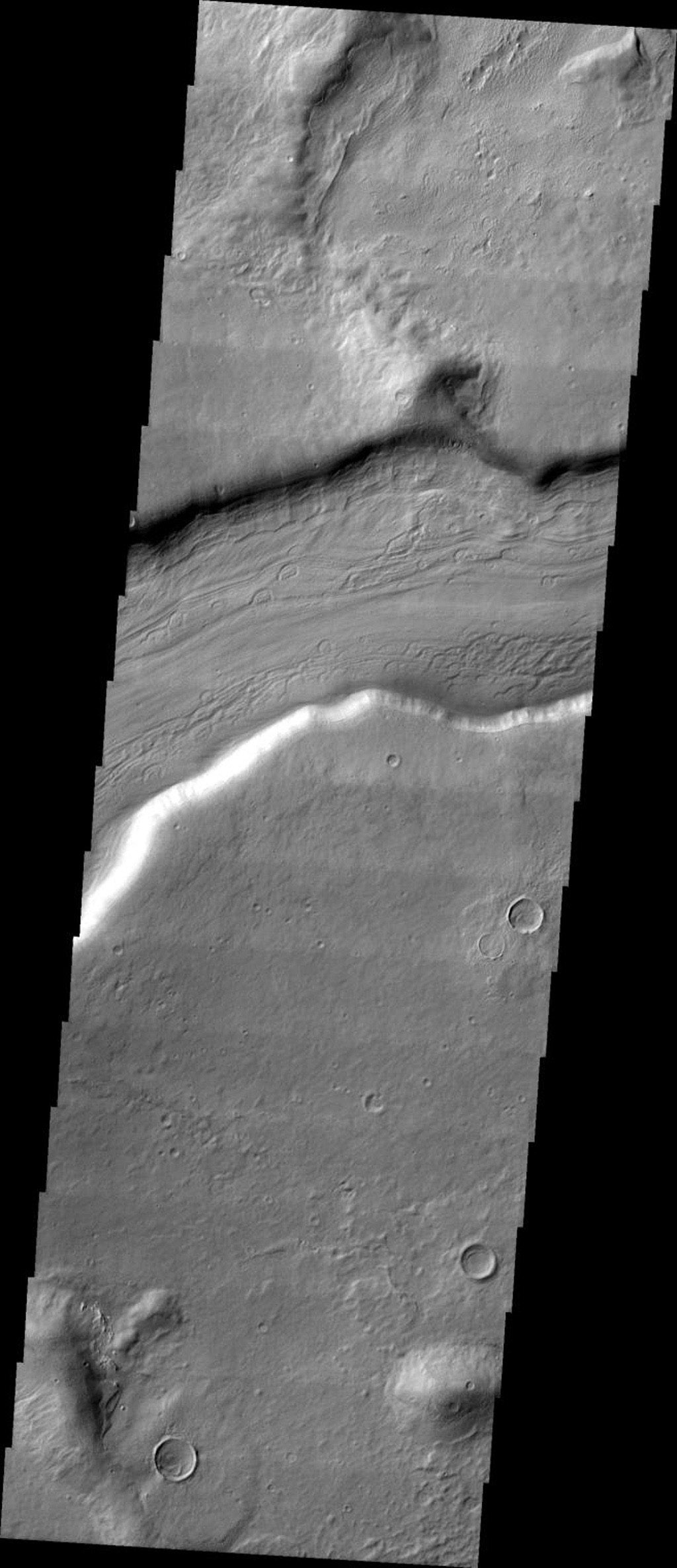 This image released on Oct 19, 2004 from NASA's 2001 Mars Odyssey shows Reull Vallis, located in the Martian southern highlands, just east of Hellas Basin.