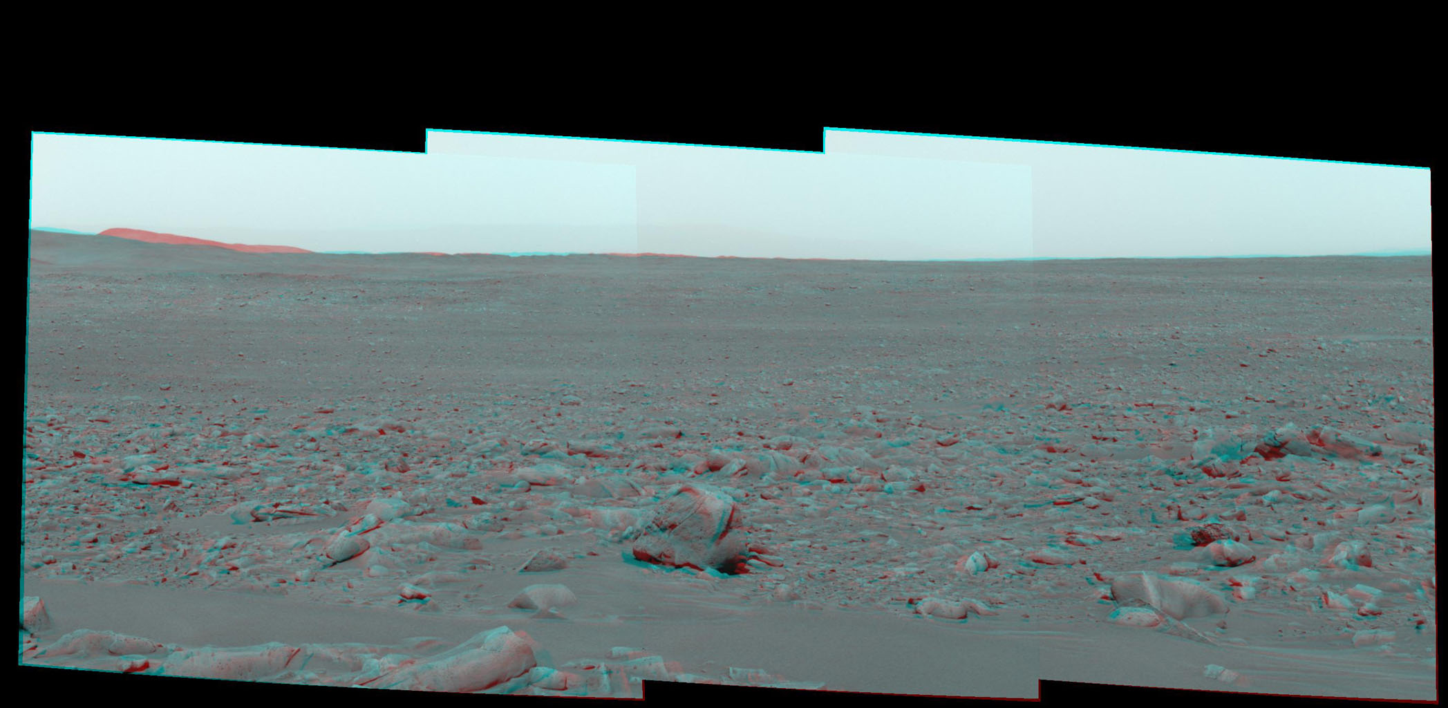 This stereo view is from NASA's Mars Exploration Rover Spirit as it was investigating a rock called 'Mazatzal' on the rim of 'Bonneville Crater.' 3D glasses are necessary to view this image.