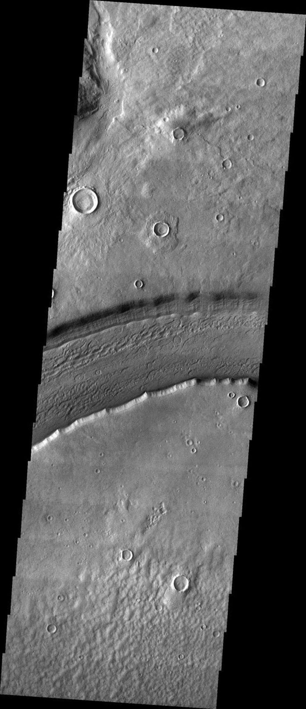 This image released on Oct 25, 2004 from NASA's 2001 Mars Odyssey shows Reull Vallis, located in the Martian southern highlands, just east of Hellas Basin.