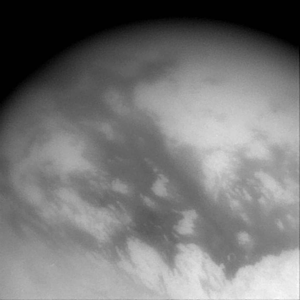 This wide-angle image captured by NASA's Cassini imaging science subsystem shows streaks of surface material in the equatorial region of Titan.