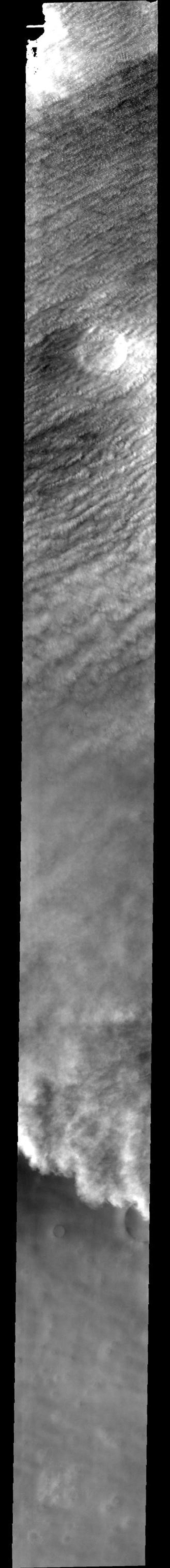 This image released on Nov 1, 2004 from NASA's 2001 Mars Odyssey shows clouds and one of the many storm fronts common in the north polar region during spring and early summer on Mars' polar cap.