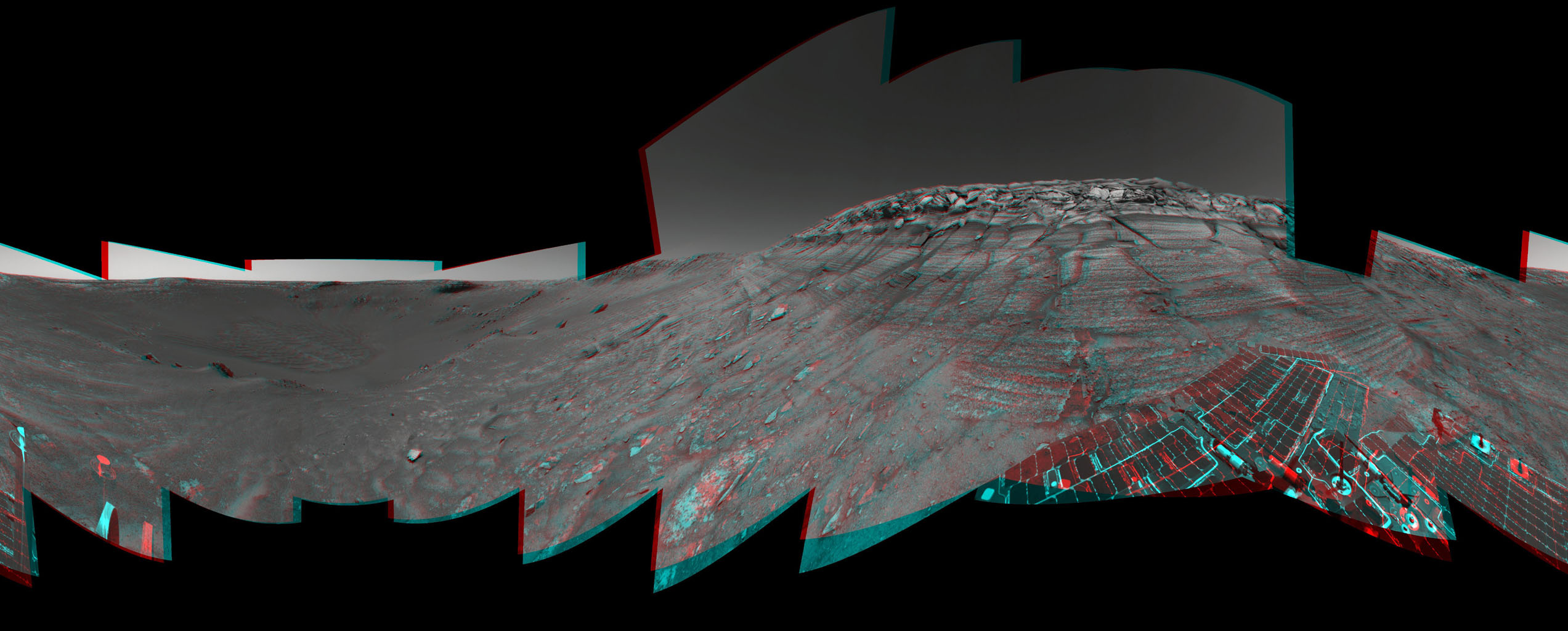 NASA's Mars Exploration Rover Opportunity reached the base of 'Burns Cliff,' a portion of the inner wall of 'Endurance Crater' in this anaglyph from the rover's 285th martian day (Nov. 11, 2004). 3-D glasses are necessary to view this image.