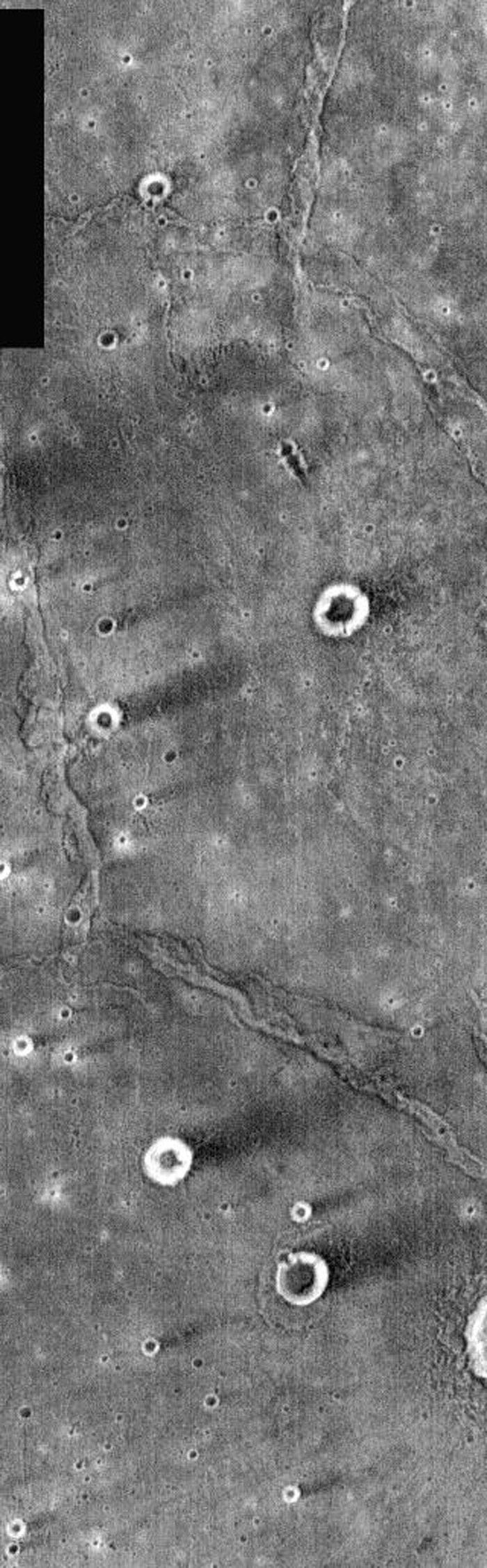 This image from NASA's Mars Odyssey shows a crater on Mars located in Syrtis Major. The majority of craters appear as bright (warm) rings surrounding dark (cooler) centers. The crater rims providr a wind-shadow.