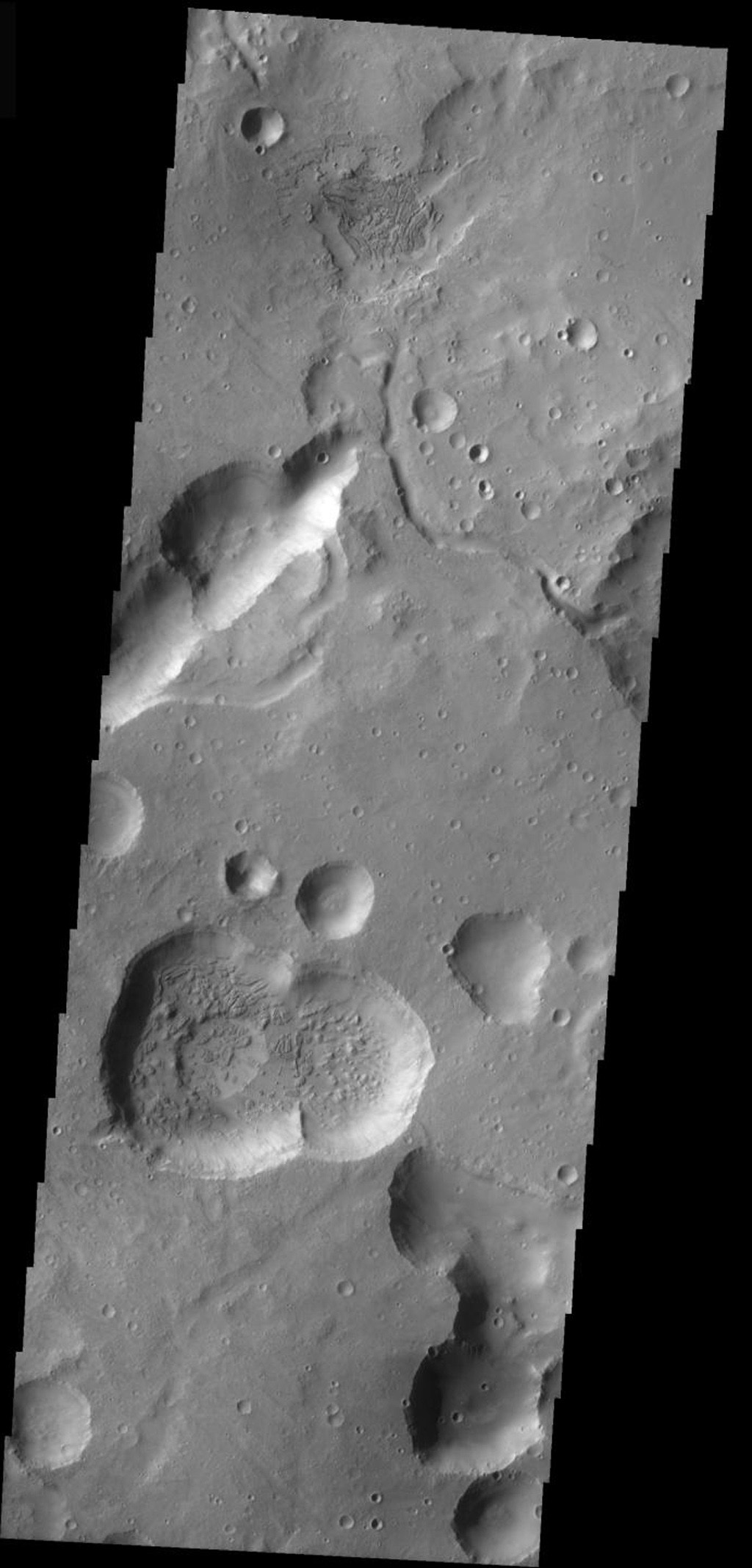 This image from NASA's Mars Odyssey is from the Cydonia region of Mars. It illustrates how difficult it can be to identify modified impact craters in a region of collapse pits/craters. Generally collapse craters/pits have no rims and form lines.
