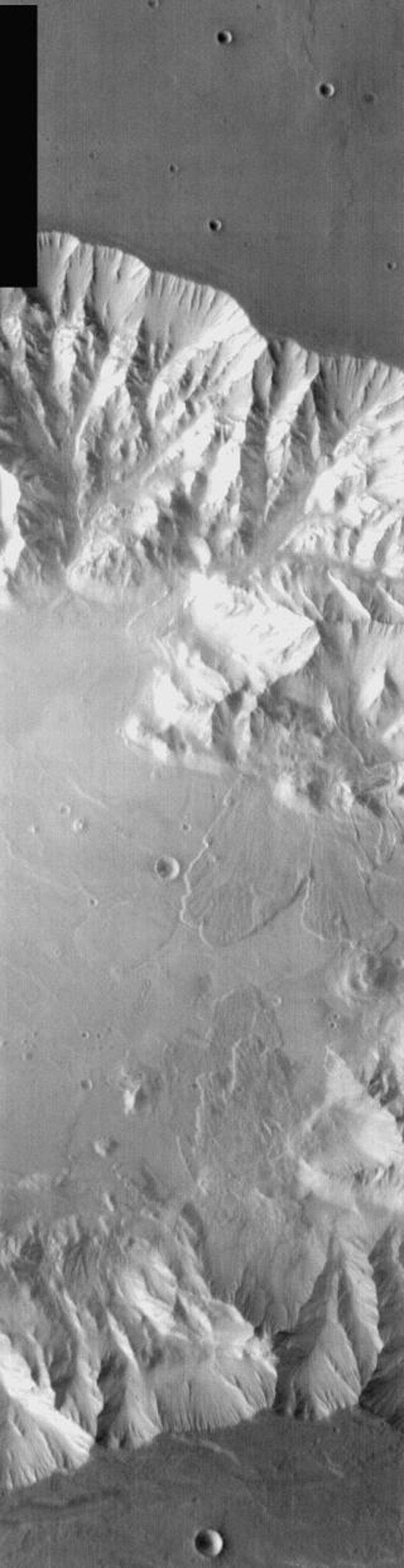 This image from NASA's Mars Odyssey shows a portion of Coprates Chasma on Mars, part of Valles Marineris with multiple large landslides.