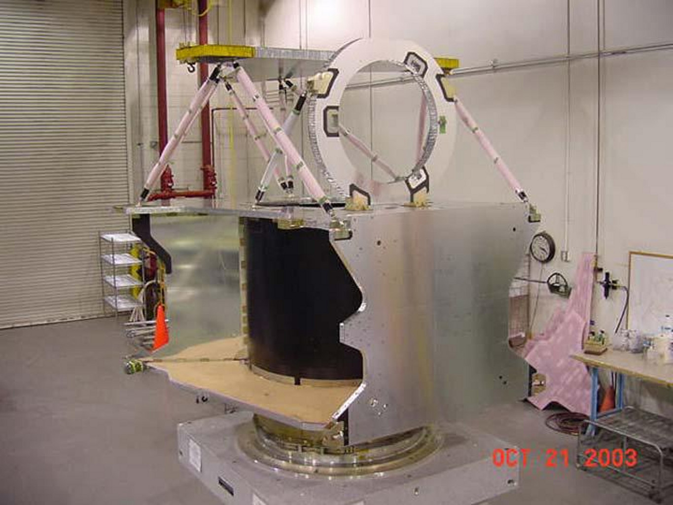 The structure of NASA's Mars Reconnaissance Orbiter spacecraft is constructed from composite panels of carbon layers over aluminum honeycomb, lightweight yet strong.
