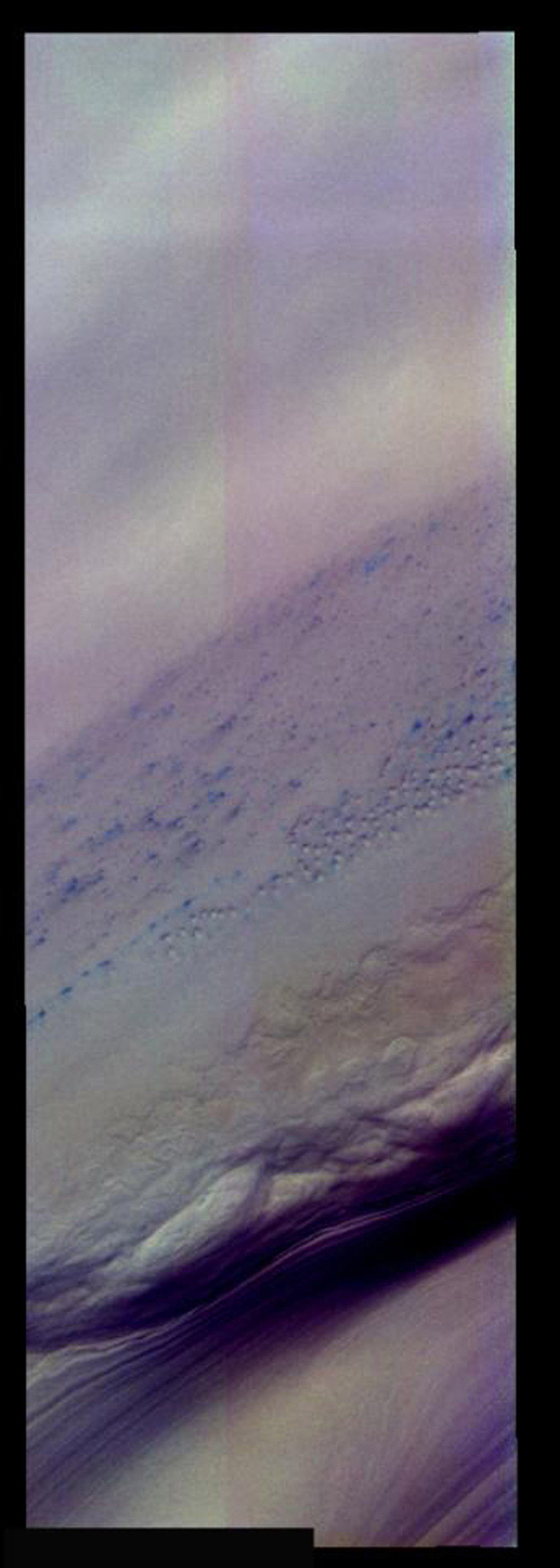 Small dunes on Mars in this false-color image from NASA's Mars Odyssey are 'bluer' than the rest of the layered ice/dust units to the left. Ice/frost will appear as bright blue in color; dust mantled ice will appear in tones of red/orange.