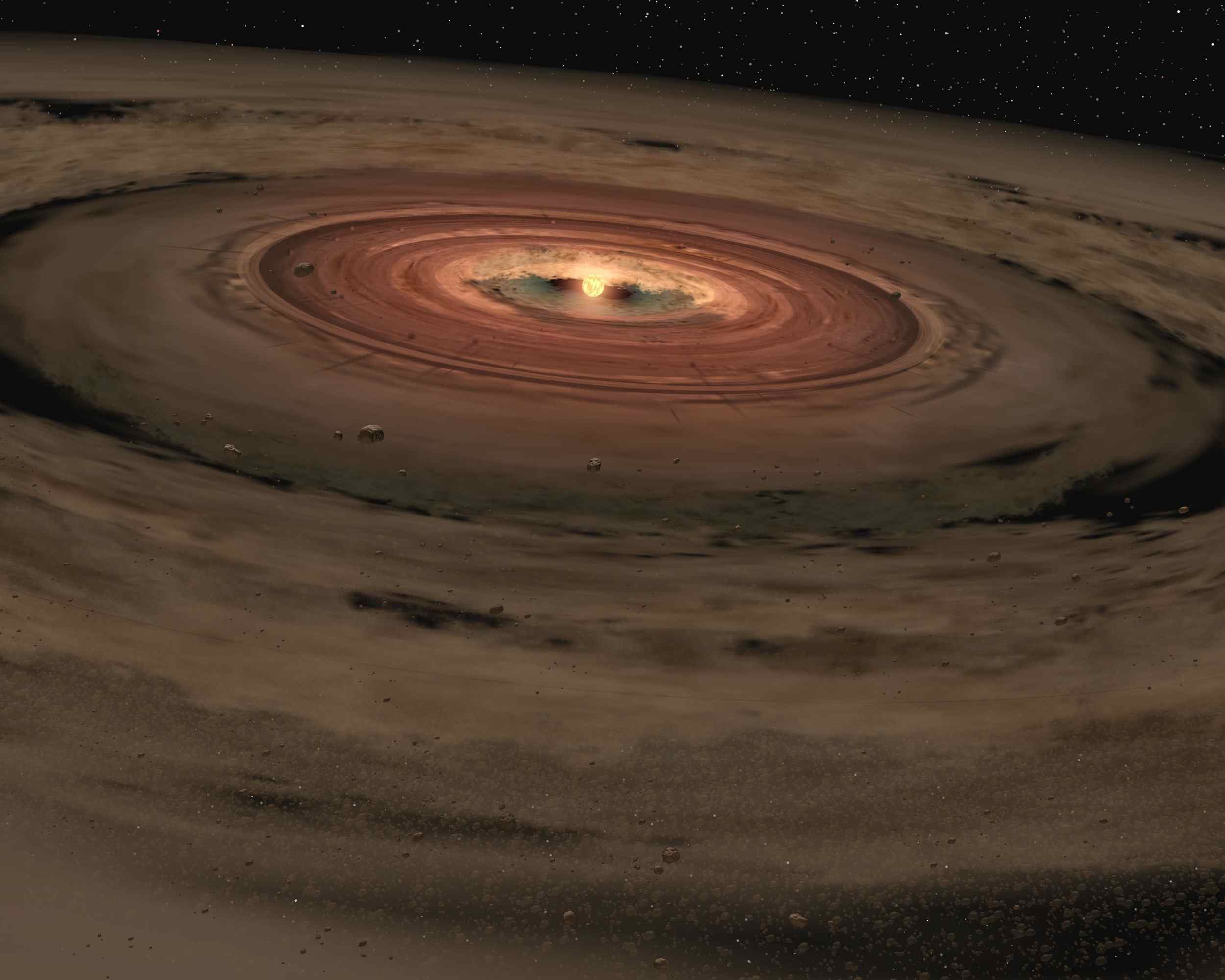 This artist's animation shows a brown dwarf surrounded by a swirling disc of planet-building dust. NASA's Spitzer Space Telescope spotted such a disc around a surprisingly low-mass brown dwarf, or 'failed star.'