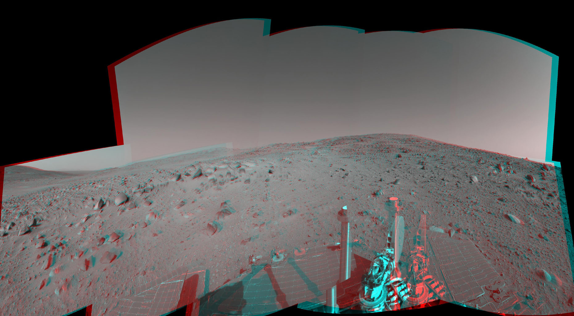 NASA's Mars Exploration Rover Spirit captured this view uphill toward 'Cumberland Ridge' on 'Husband Hill.' 3-D glasses are necessary to view this image.
