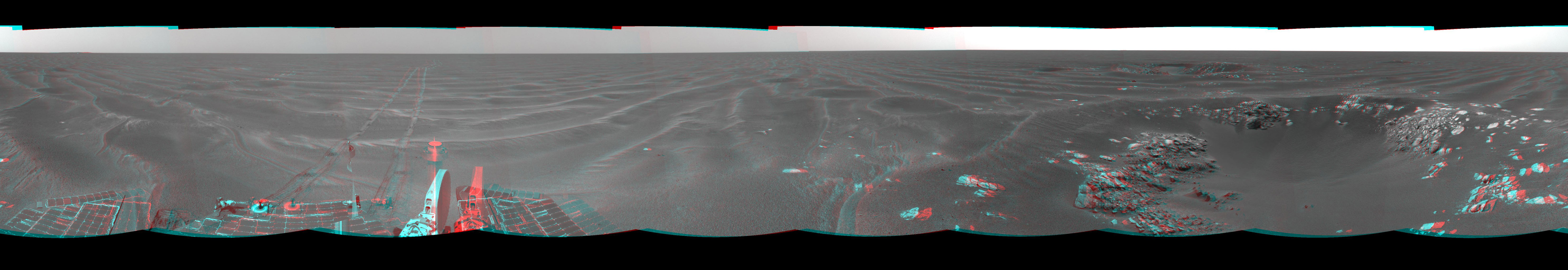 On Feb. 24, 2005, NASA's Mars Exploration Rover Opportunity had driven about 73 meters (240 feet) and reached the eastern edge of a small crater dubbed 'Naturaliste,' 3-D glasses are necessary to view this image.